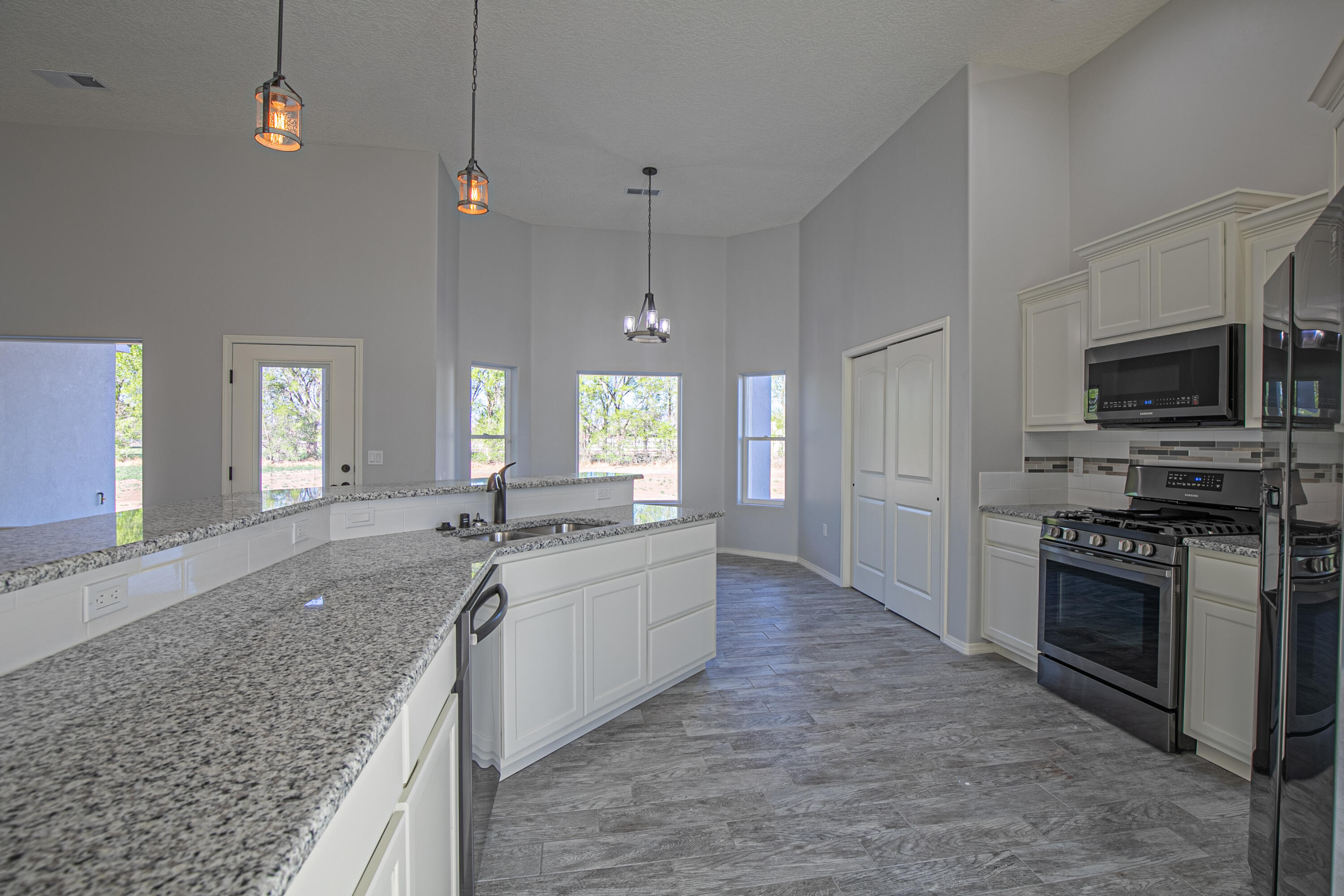 Welcome to this exquisite custom home (Montana) situated on 1.88 acres of beautiful valley land. This home features master suite with large walk in closet, separate shower, & double sinks. 3 Bdrm w/office & closet so possible 4 bdrm. The kitchen is complete with an abundance of custom cabinets, including island, a sizable pantry & Stainless/black appliances, granite counters tops throughout and semi glodd paint. The open living room leads out to the back covered patio which is perfect for entertaining. This is a spec home and all features, colors and  designs have been pre-determined. Photos of same floor plan (different address)  but different colors and features may vary.