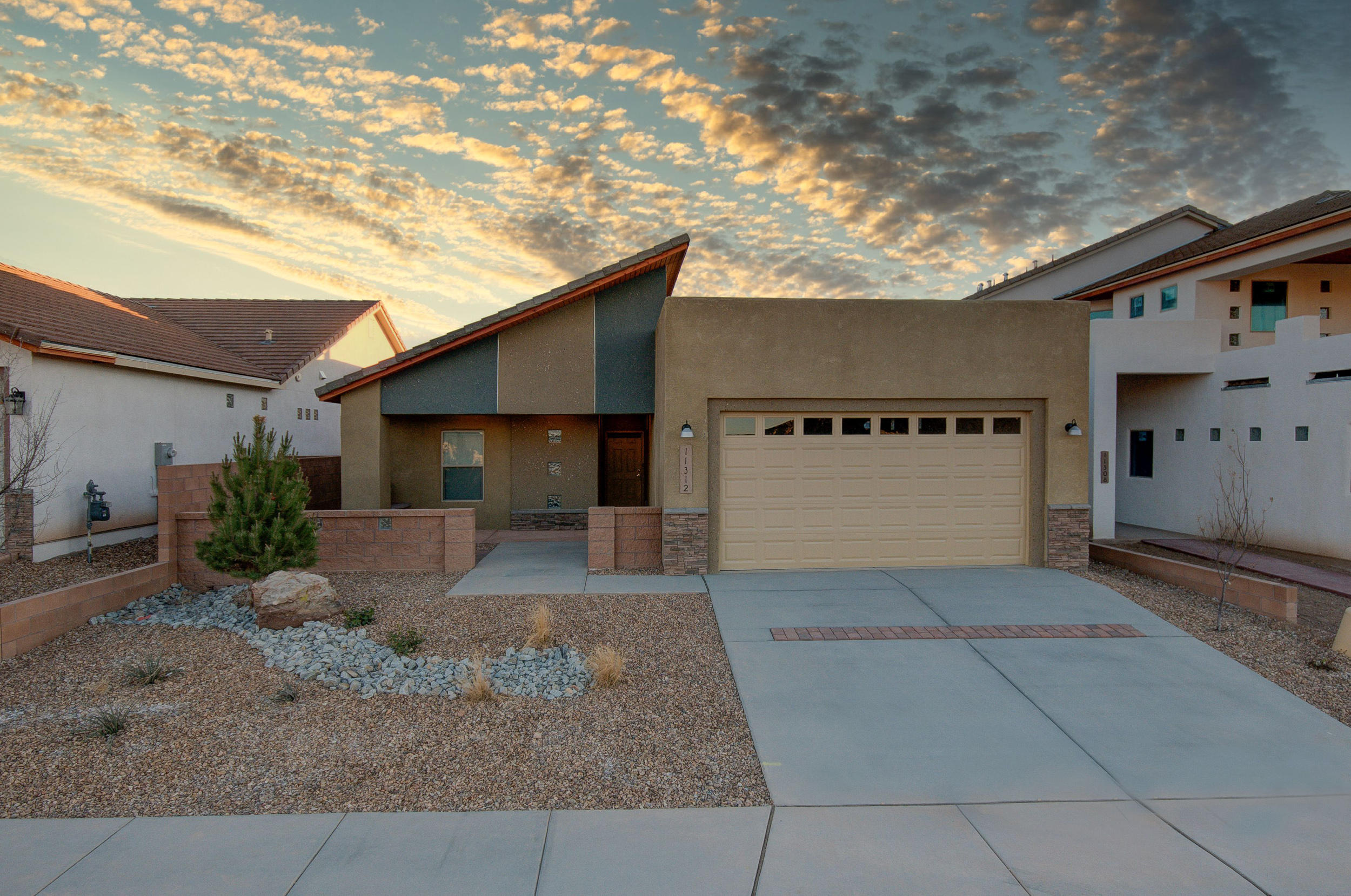 Nice Courtyard Entry into this Beautiful New Constuction Home Complete with Easy Maintenance Front and Backyard Landscaping as well as Window Coverings Thru-Out.  Enjoy Cozy Evenings by the Pretty Staked Stone Gas Log Fireplace In the Family Room, which Opens to a Very Pretty Kitchen with Breakfast Bar, Quartz Countertops, Stainless Steel Appliances-Gas Range, Microwave and Fridge, Pantry, Tile Flooringand a Good Sized Dining Area. Check Out the Large Mastersuite with Walk-In Closet, Bath with Double Vanity, Large Shower and Pretty Tile Flooring. Really Nice Covered Front and Back Patio's To Enjoy the Warmer Weather.  It's Built Green to Emerald Level for Huge Utility Savings. Refrigerated Air, Low-E Windows, High Efficency Furnace & So Much More. Check it Out Today.