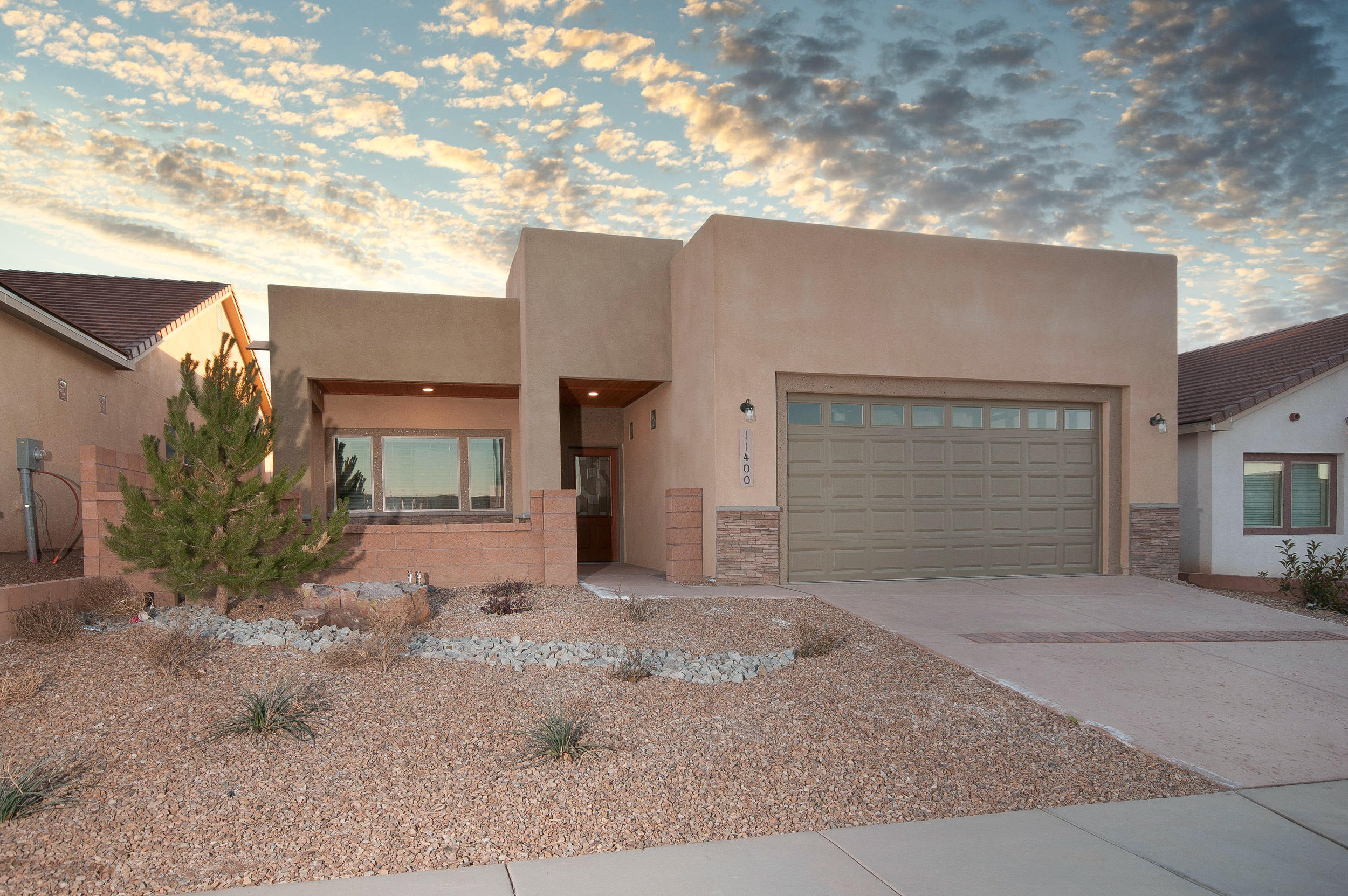 Nice Courtyard Entry into this Beautiful New Constuction Home Complete with Easy Maintenance Front & Backyard Landscaping & Window Coverings Thru-Out. Enjoy Cozy Evenings by the Pretty Staked Stone Gas Log Fireplace In the Living/Dining Rm Combo, Pretty Kitchen with Breakfast Bar, Quartz Countertops, Stainless Steel Appliances, Pantry, Tile Flooring and Family or Formal Dining Room.  Check Out the Large Mastersuite with Walk-In Closet, Double Vanity, Granite C-Tops, Large Shower w/Tile Surround,Pretty Tile Flooring. Covered Front and Back Patio's To Enjoy the Warmer Weather. Finished Garage w/Epoxy Painted Floor. It's Built Green to Emerald Level for Huge Utility Savings. Refrigerated Air, Low-E Windows, High Efficency Furnace & So Much More