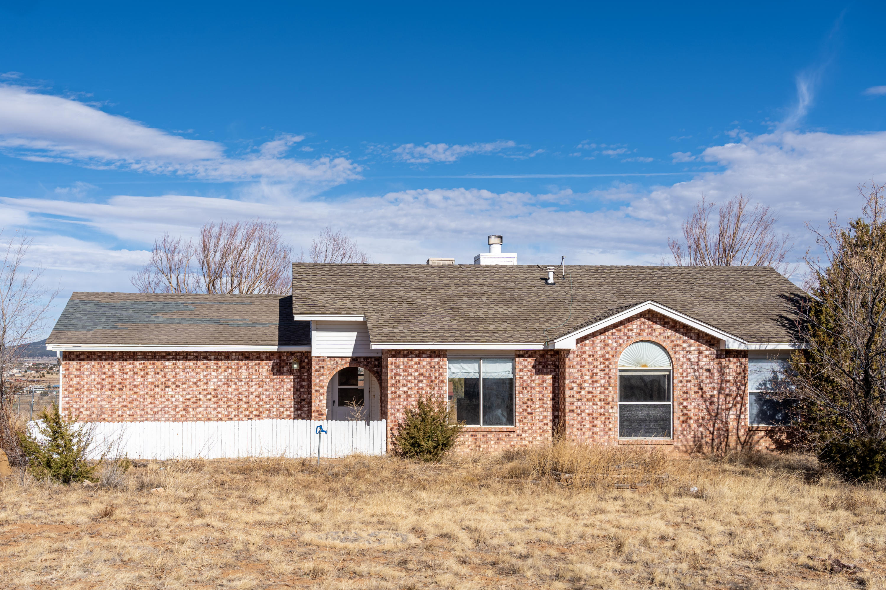 Newly updated, light filled, 3 bedroom, 2 bath home on an acre is waiting for you! All appliances stay with the home! Converted garage with private entrance allows for a second living space or an office! Great views of South Mountain from the spacious fulled fenced backyard!