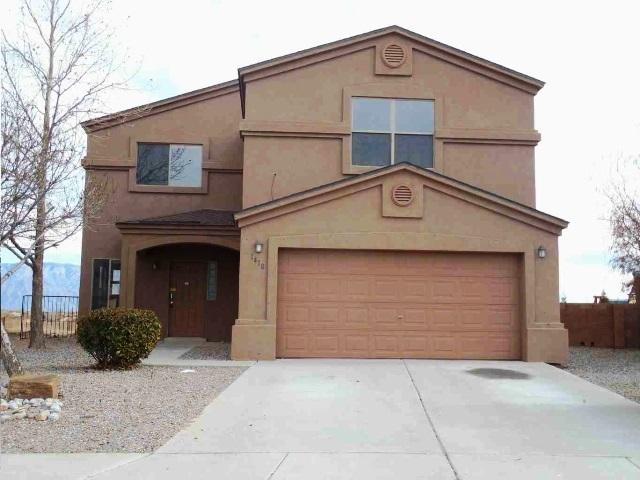 Traditional 2 Story Style home in Rio Rancho, NM, in Northern Meadows subdivision is a must see fixer, that features 5 bedrooms and 3.5 bathrooms, island in open kitchen, fireplace in family room, separate dining room,  covered back patio, balcony off master, nice fenced back yard. Bring your designer mind set to make this one your own,