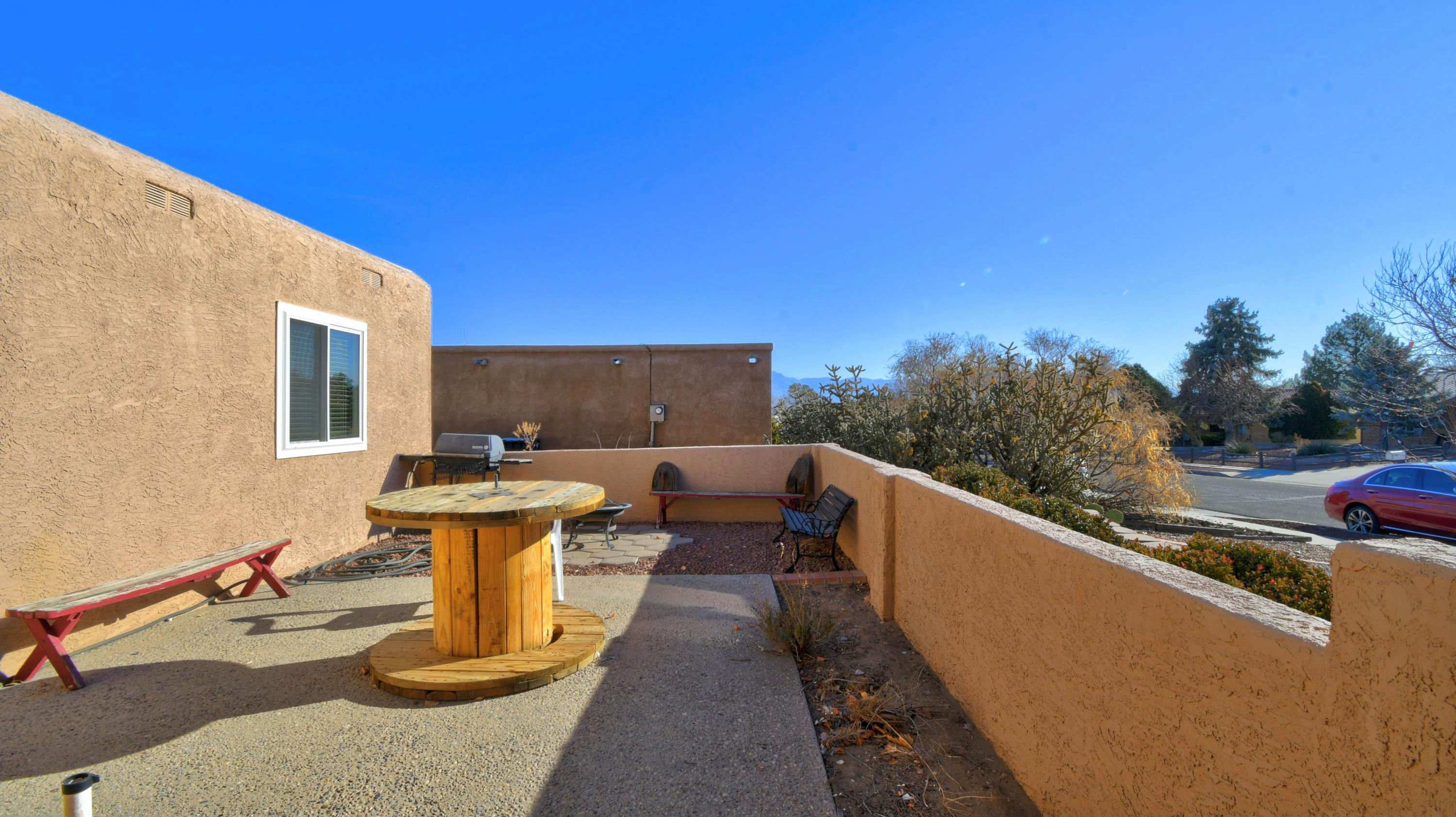 Come bring your Buyers to this BEAUTIFUL PUBELO STYLE HOME located on a corner lot with  Mountain Views and City Views from your  backyard w/putting green and water fall. Enjoy the wrap around porch in  your private backyard that also includes a storage  shed.  Great courtyard welcomes you to this updated single story home in this desirable Taylor Ranch Area. Beam & Tongue/Groove Ceiling-kiva Fireplace w/banco pellet stove insert, wtih Hardwood Floors & vigas in Living room . Features 2 Living Areas with a spacious family room that is PERFECT for ENTERTAINING. Master Bedroom and 2nd Bedroom have cork flooring.All Appliances stay, BIG laundry room w/cabinets, shelving and utility sink. Backyard access and room for RV with a dump access. Updated windows & fairly new TPO Roofing.