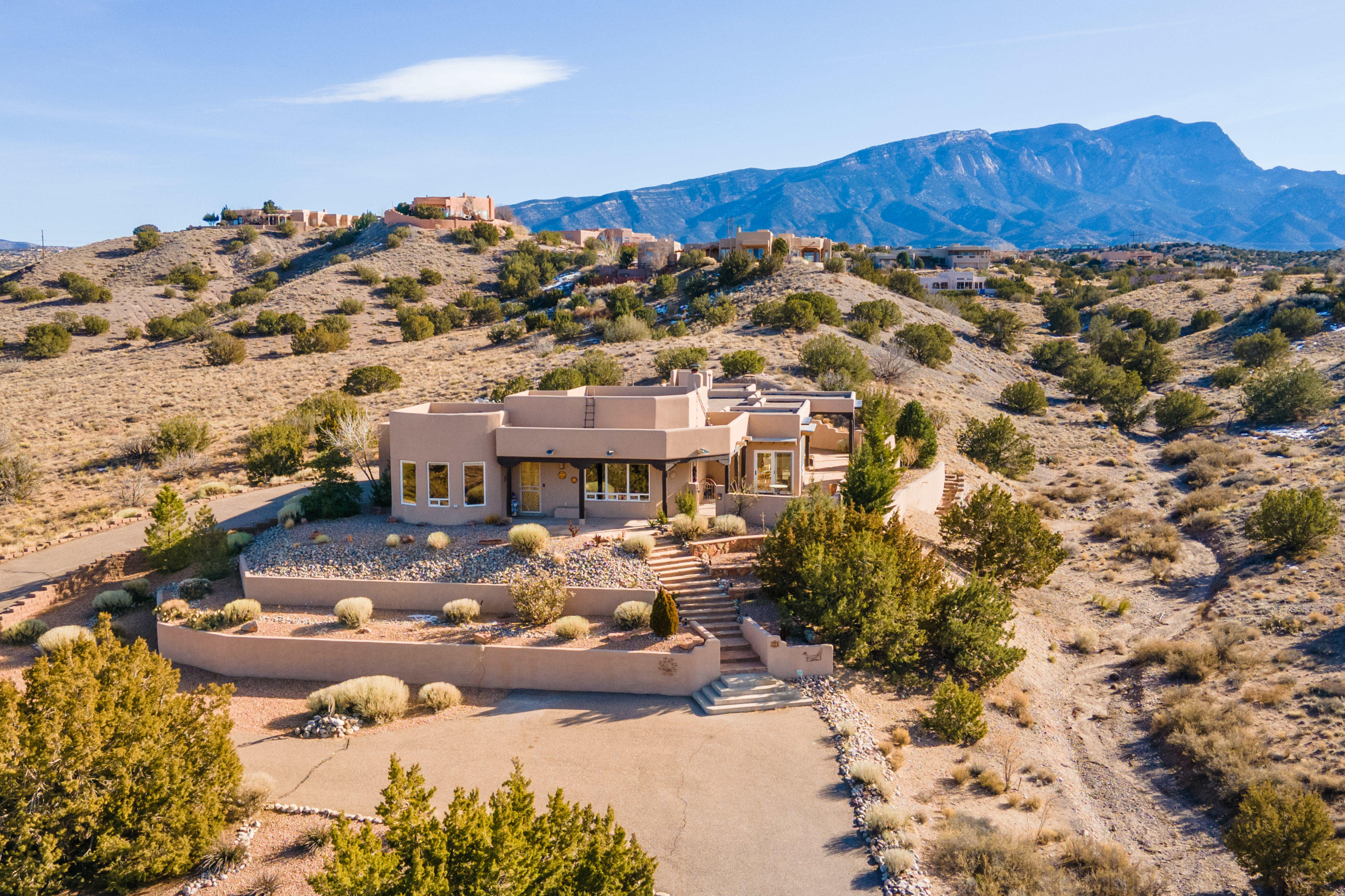 Located at the end of a private road in the desirable Sundance Mesa subdivision, this single level custom home has been thoughtfully updated and lovingly maintained throughout! With direct access to over 5000 acres of BLM land and trails, this home is an outdoor enthusiast's dream! The open concept floor plan is filled with natural light and showcases the amazing Western Mesa and Jemez Mountain views. The great room features 14' beamed ceilings, a cozy kiva fireplace and opens to the extensively remodeled chef's kitchen with amenities including: 2 large islands - one with wine and beverage coolers, a breakfast bar, beautiful dining area with custom banco, quartz countertops, s/s appliances . . . Please click ''More'' for additional information on this incredible property . . .