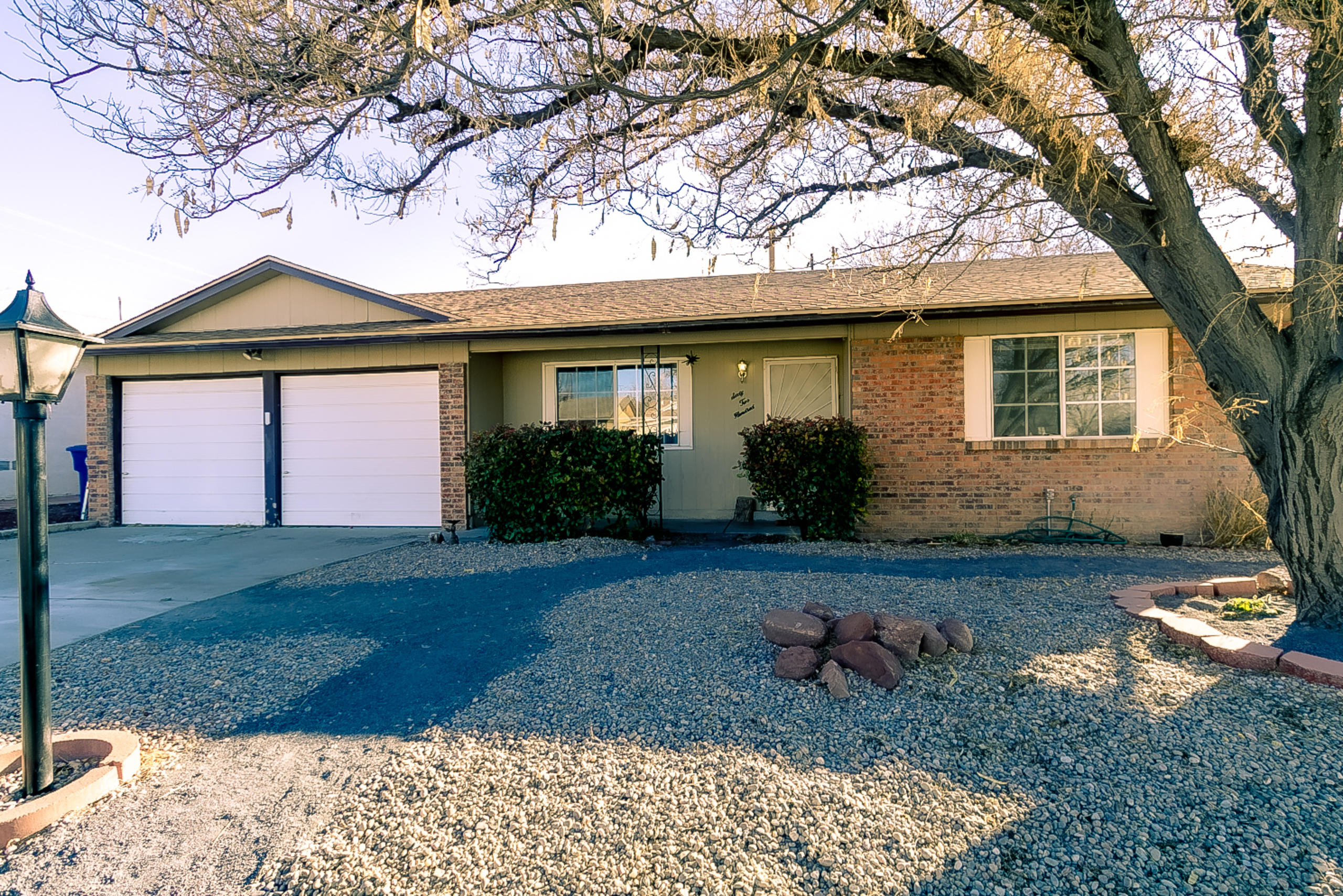 Looking for a fabulous Ranch Style home in NE Heights Albuquerque w/backyard access? Here it is! New Roof in 2017. Updated kitchen w/ shaker style cabinets, solid surface countertops w/ intergraded sink, large walk in pantry, breakfast nook & breakfast bar.  Beautiful laminate flooring in main living areas and hallway. New carpet in bedrooms. New interior paint. Cozy wood burning fireplace in family room. Owners suite w/  3/4 bath that includes a updated custom tile surround and new vanity. Good size secondary bedrooms. CFA heating. Master cool evaporative cooling. Home is situated on corner lot w/ backyard access. Designated kids play area in backyard. Large covered patio. Mature shade trees & low maintenance landscaping. Rare find in NE! Added rm in garage not incl in sq. ft.