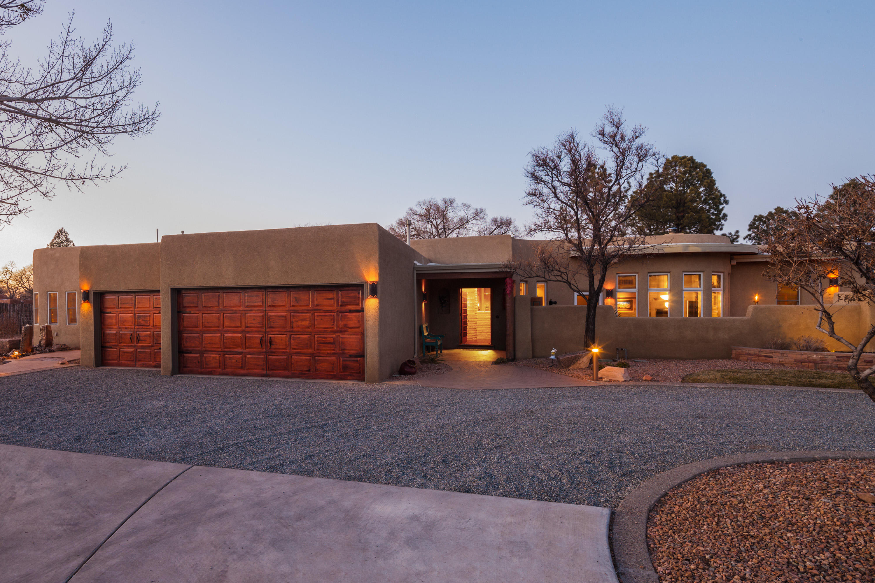OPEN HOUSE Saturday, January 16, 12pm-4pm BY APPOINTMENT with Listing Broker. Nestled in the Greenbelt of Los Ranchos de Albuquerque, between celebrated Rio Grande Boulevard and The Rio Grande itself, this custom luxury Southwest home is ready to welcome you. With gated access to miles of beautiful Bosque from the private road, this is peaceful, North Valley living at its finest. This immaculate home presents with classic Southwest features, like exposed Adobe walls, Vigas, brick and hardwood floors, and (gas) Kiva fireplaces. The custom kitchen, features a warm, copper tone backsplash between the base and upper cabinets, and behind the stovetop, local New Mexico pottery artist, Kelly Jo, lends her Yellow Lavender pattern to the wall. The main part of the home has two living areas, (more)