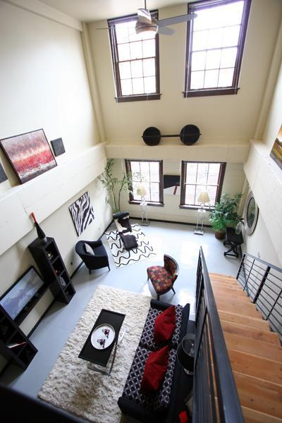 Located in the 1938-built historic Gymnasium building at The Lofts at Albuquerque High in East Downtown (EDo), this loft features two spacious levels with entries on both levels, island kitchen, 2 full baths, high ceilings, North-facing operable windows, painted concrete floors and iron railings on staircase, washer/dryer connections. Access to beautifully landscaped secure courtyard with grill, fountains, seating. Secure building. Common lobby area. Secure parking available at City-owned garage across the street at 100 Arno. Association dues cover water/sewage/trash/recycling, insurance, common area maintenance, reserve contribution. Association allows up to 2 pets (dogs/cats/birds/fish). No AirBnb or the like allowed.