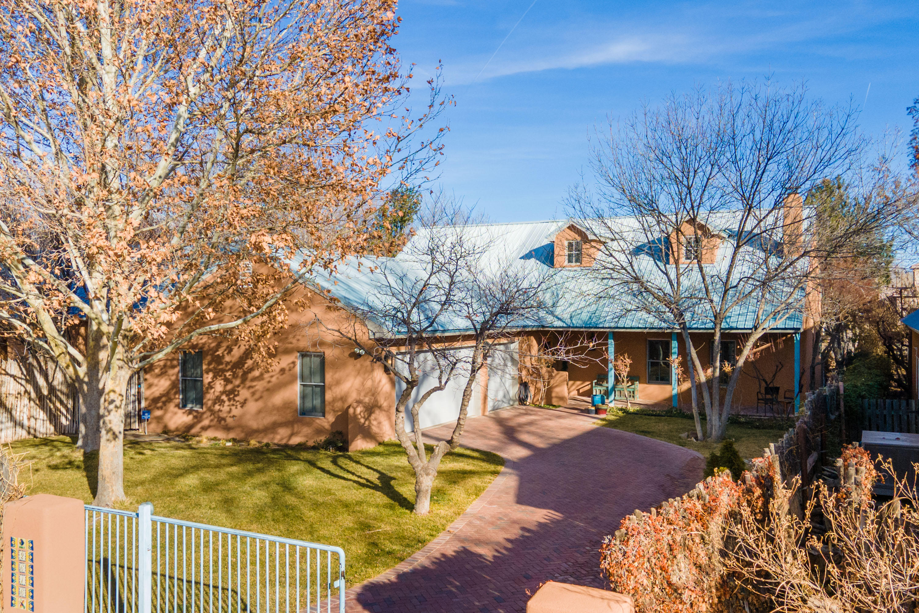 WOW. Open concept dream floorplan for today's work/school from home lifestyle.  Quintessential North Valley Northern New Mexico style custom home on a quiet, peaceful, serene cul-de-sac. The light-filled interior is open & spacious, featuring several interior adobe walls as design accents, cathedral ceilings, and two living spaces.  Entertainer? Love to cook? Enjoy the outdoors? Look no further! The spacious master suite includes a completely remodeled incredible spa-like bath, with individual lighted mirrors. Unbelievable kitchen just remodeled! The upstairs loft offers office space with a large built in counter for desk or crafting, also could be your media room or playroom, or gym. Refrig. air, radiant heating, 3 bedrooms, 3 full bathrooms, open kitchen, and 3 car garage. Offer NOW!