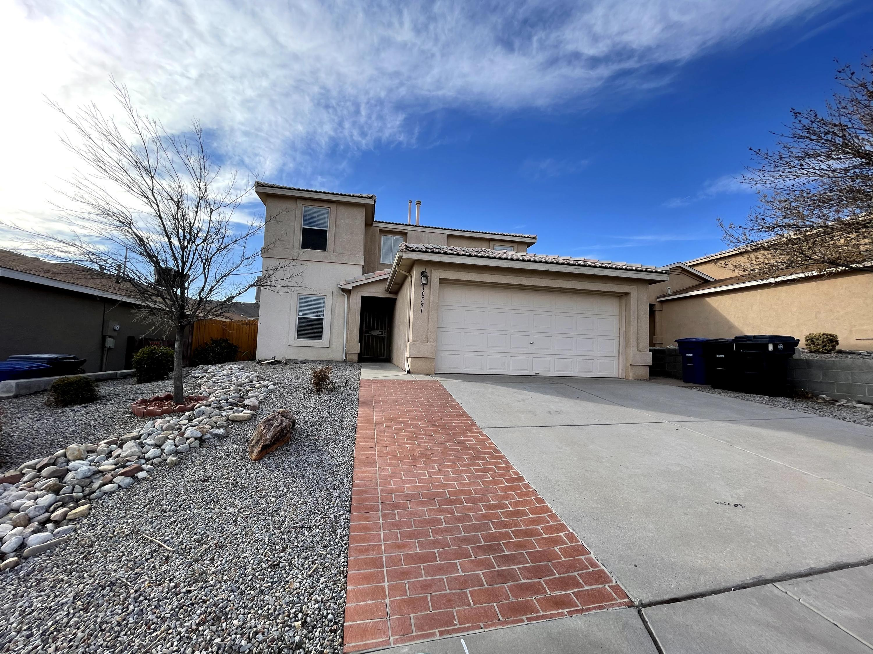 This gorgeous home is ready for new owners! Located in the Tuscany Ridge Subdivision of NW Albuquerque, this home has 4 bedrooms and 3 full bathrooms. One bedroom is conveniently located downstairs with a full bathroom right next to it! This home has a huge walk in pantry for extra storage and is known as the ''Costco Pantry''. In the owner's suite you will find a relaxing garden tub and large walk in closet. The large backyard includes a dog run and covered patio. All new carpets! Don't miss out on this amazing home!