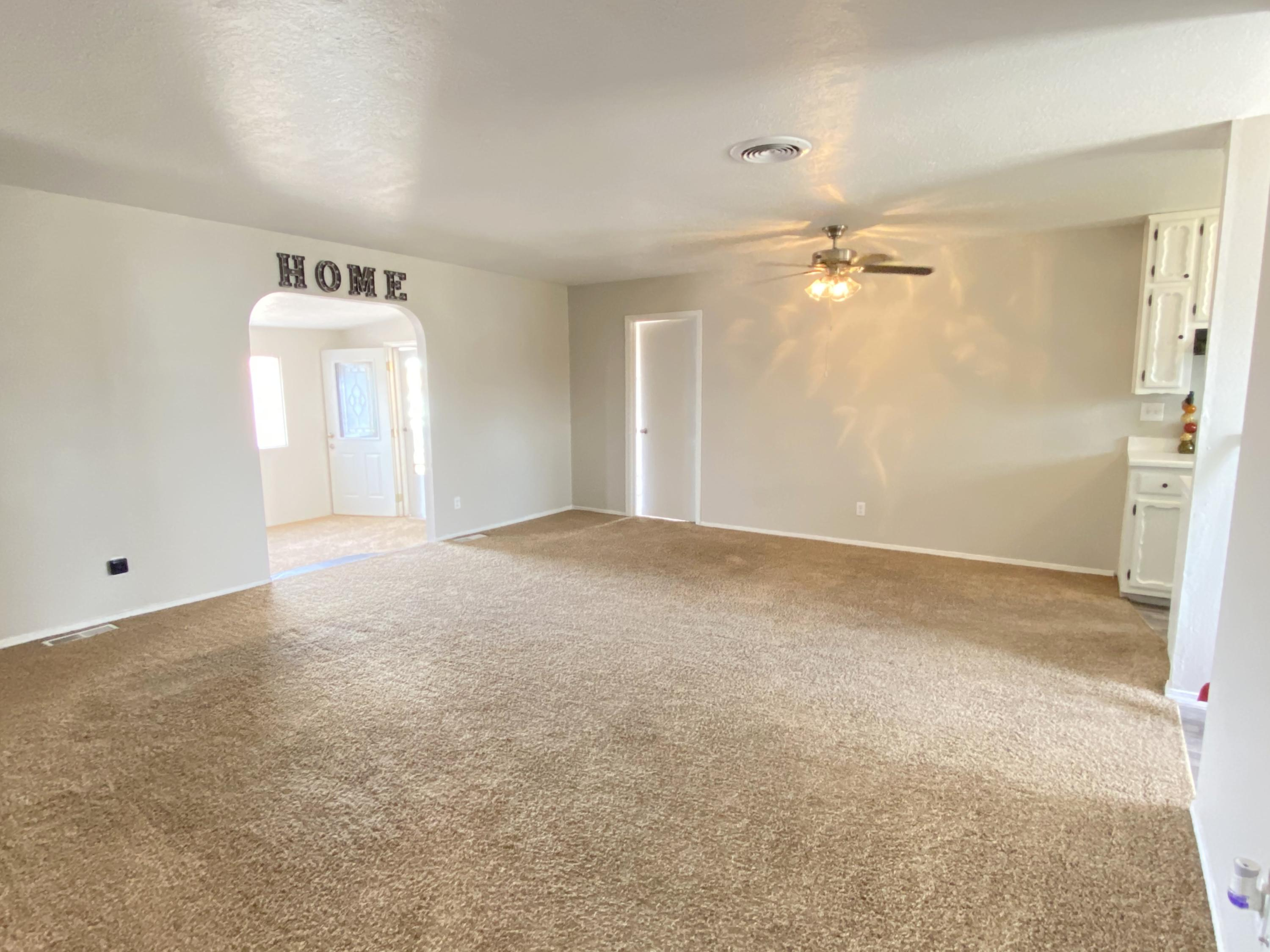 Charming 1,300 SF Home Located in the Quiet Neighborhood of the Luna Addition.  3 Bedrooms and 1.5 Baths.  BIG Square Lot is almost 1/4 Acre.  Large 250 SF Living Room PLUS a 200 SF Den/Game Room/Office etc. Master Suite has Walk-In Closet and Bonus 2nd Closet.  Newer Carpet Throughout, Updated Kitchen and Bathrooms.  BIG Backyard with Storage Shed, Lawn and Several Trees.  Back Yard access for storing RV, Boat, etc.  Close to Several Amenities: Grocery, Retail, Restaurants, Home Improvement Stores, the Luna Mansion, Teofilo's and the Rail Runner Station.