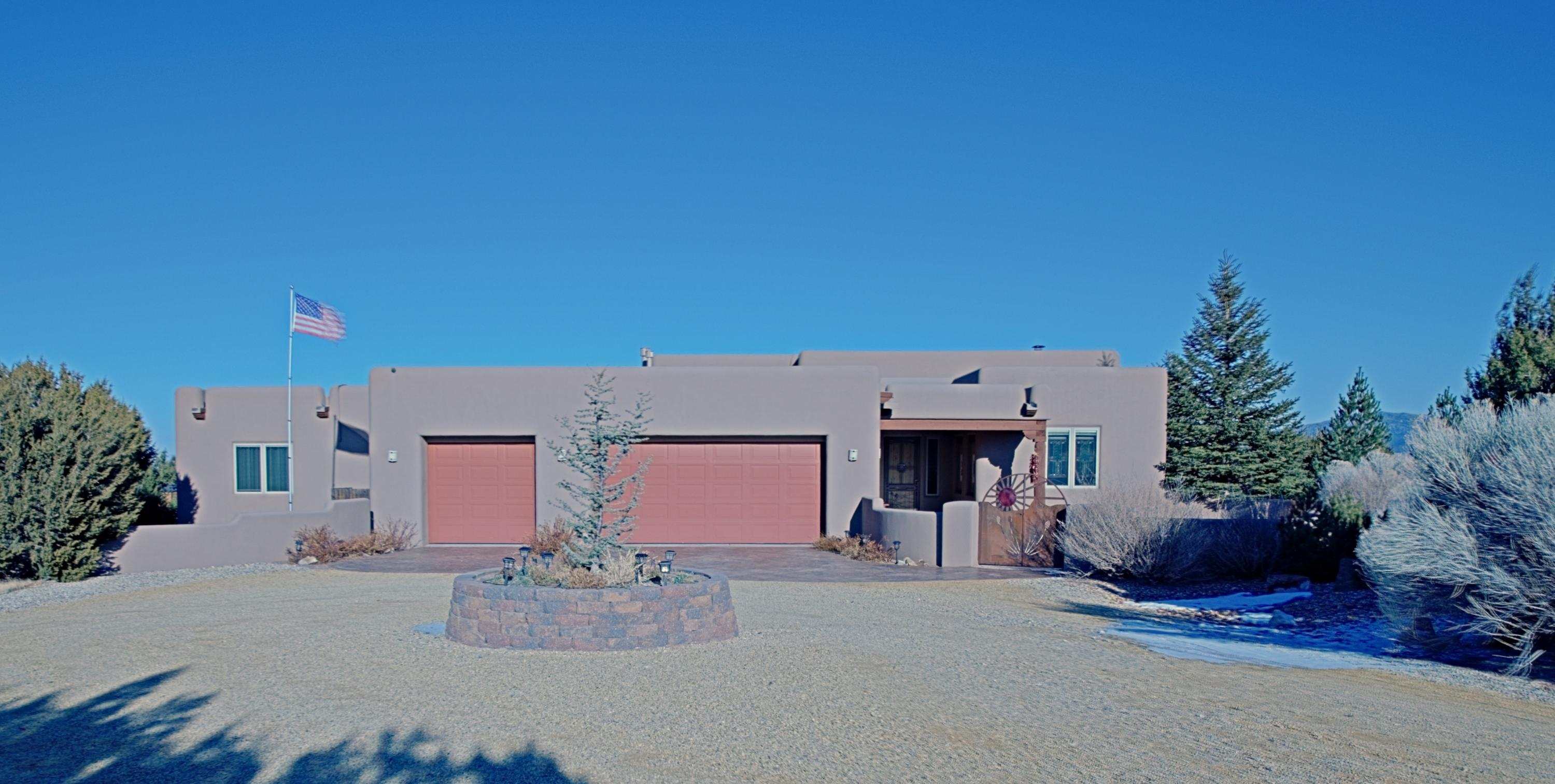 A Show Stopper! How would you like to live in a community where all the homes are on 10 acres surrounded by five majestic mountain ranges where you can hike, bike and ride horses to your heart's content? Located in San Pedro Creek Estates just an easy 35 minute drive to Albuquerque and 50 minutes to Santa Fe you have the best of both worlds. This home is an exceptional Crombie built home all on one level. With over 3100 sq ft to enjoy and two walled courtyards beautifully landscaped including a backyard water feature. The oversized garage is large enough to house the perfect man cave area and contains the temperature-controlled wine room, a sauna and the third garage bay can be used for storage, exercise equipment or for a third vehicle.  Schedule a showing today, this will not last long!