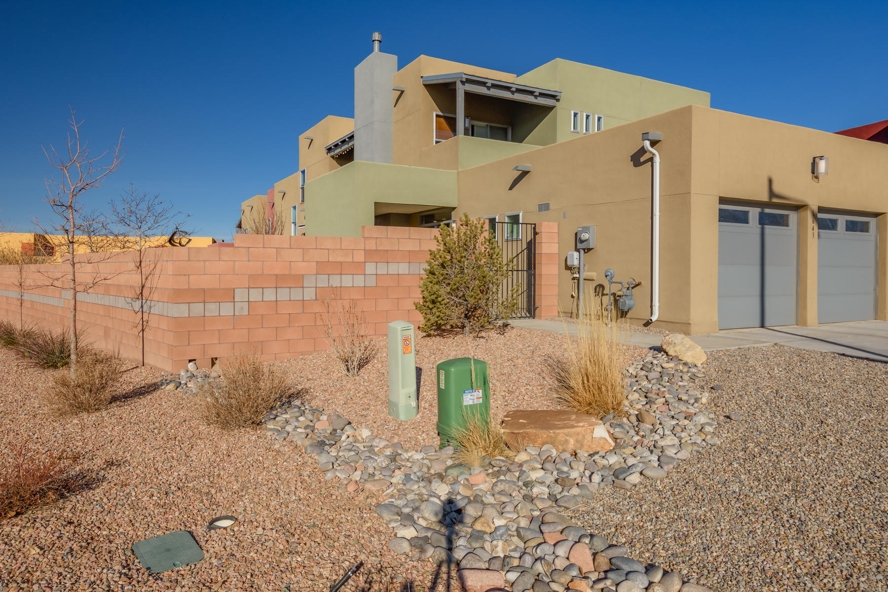 Gently lived in RayLee Home w/ $22,000+ of Add'l Upgrades Including An Awesome Motorized Custom Patio Awning, Over $3K In Window Treatments and $12K in Landscaping-Sprinklers-Planters & Patio Pavers. Corner Lot Boasts 2 Upper Balconies to Enjoy The Sandias* The Spacious, Open Main Floor Features Soaring Ceilings, Neutral Tile Flooring In The Public Areas, Upgraded Lighting, Gas Fireplace AND A Bedroom w/ Tiled Bath* Stainless Steel Appliances, Silestone Countertops, Brkfst Bar & Abundant Cabinets Make This Kitchen A Joy* Newer Refrigerator, Washer & Dryer negotiable! The Master Bedroom & Bath Are Well Appointed w/ a Huge Walk In Closet, Oversized Shower & Soaking Tub! Close to Kirtland AFB, Sandia Labs & Shopping!
