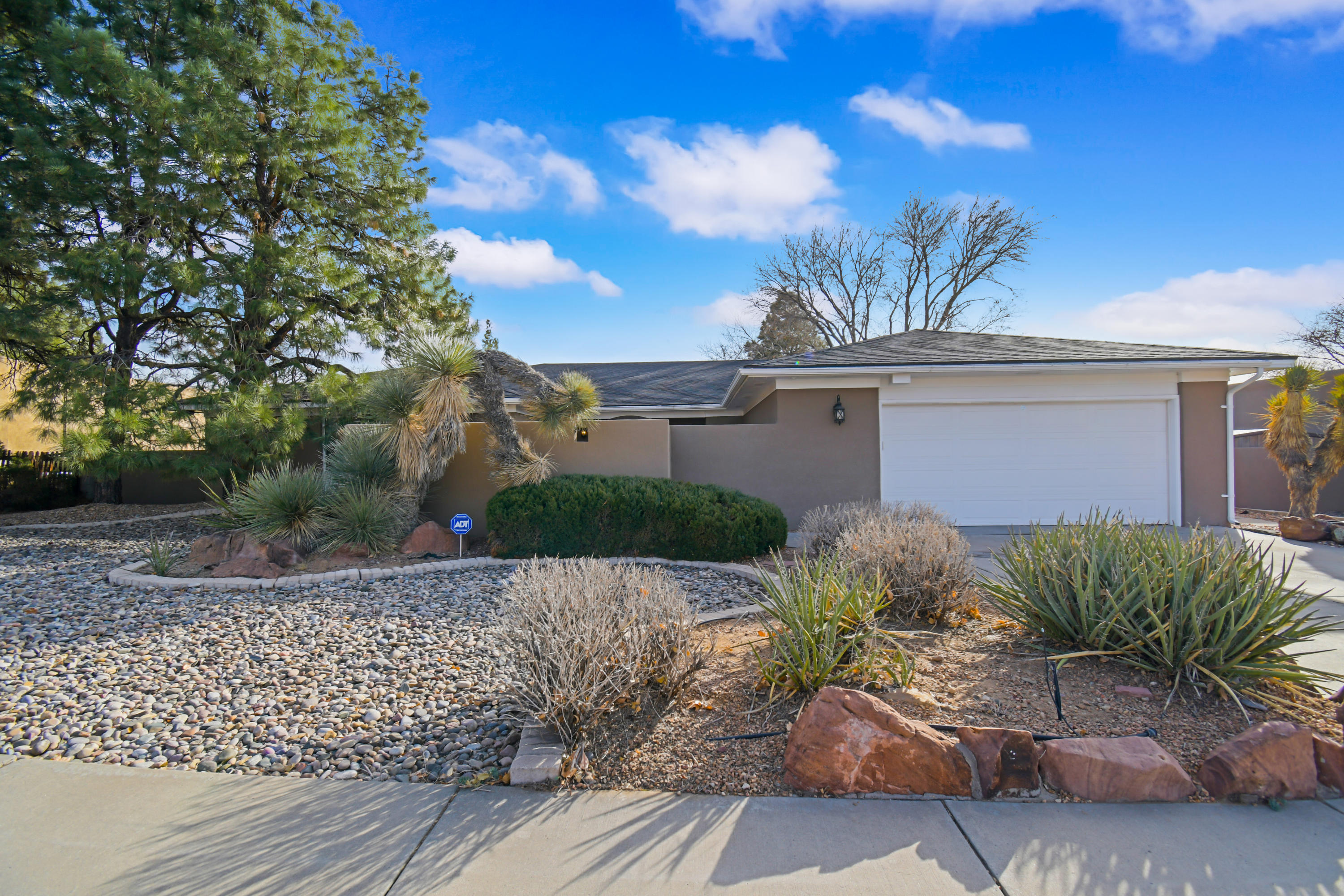 Beautiful Bear Canyon! This custom single story custom Mossman home has a bright and open front foyer entry. The living room has access to a formal dining room & sunroom. The  greatroom boasts a fireplace and built-in cabinets. Enjoy the eat-in country kitchen w/breakfast nook & service room. 4 big bedrooms plus possible 5th bedroom/office & bath. This house has great storage & lots of light along with an extra wide lot with patios & more! Make an appointment to see it today!