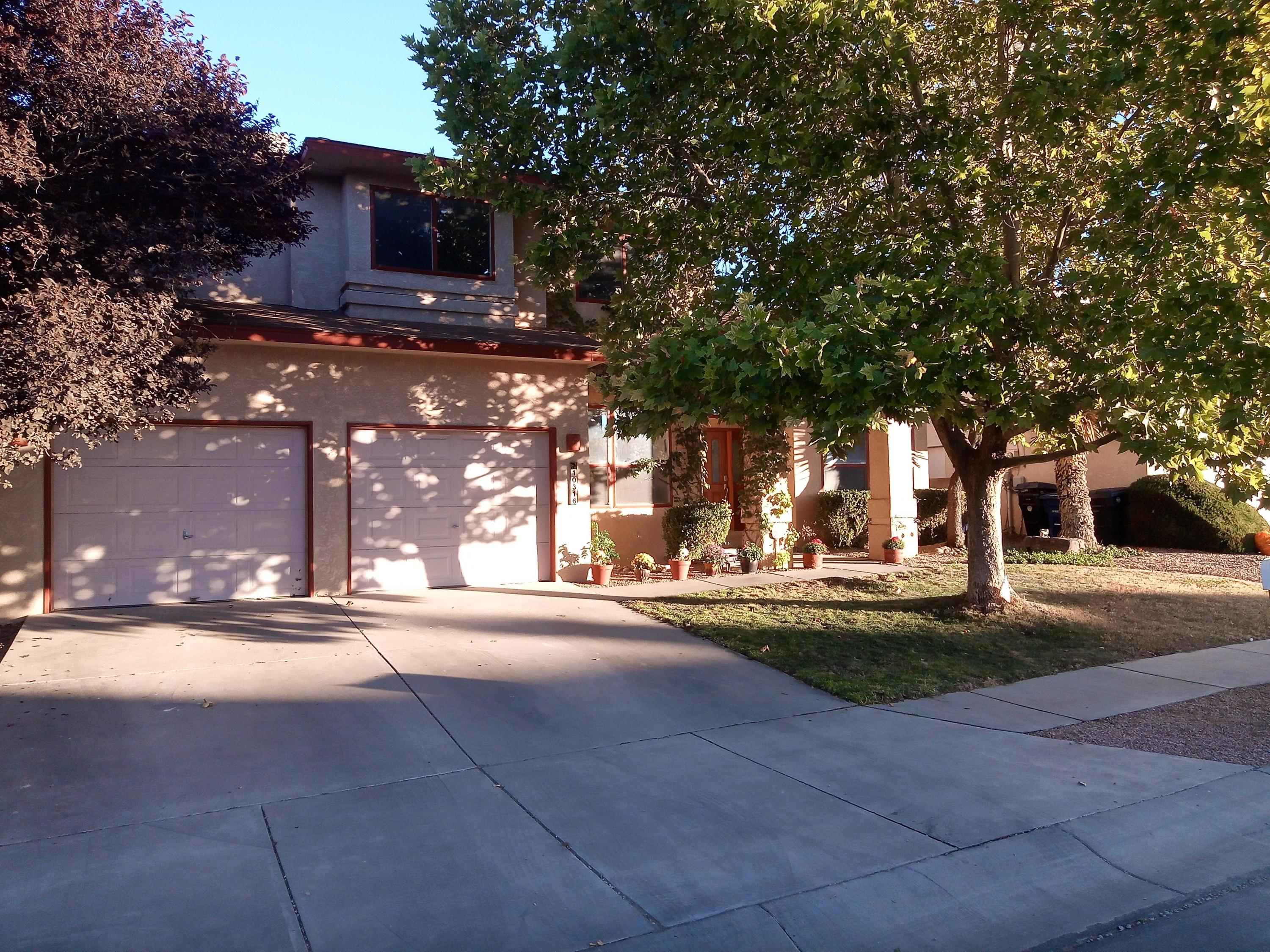 This spacious 3,559 square-foot three-level home features 5 bedrooms, 2 bonus rooms, 3-1/2 bathrooms, and a 2-car garage. It is tucked away in a beautiful, friendly, and safe neighborhood and has unobstructed view of the Hunter's Run park, city, and Sandia Mountains. The main level features open floorplan with large windows, two dining areas, powder room, island kitchen, and walk-in pantry. The upstairs contains the master suite with a walk-in closet, two bedrooms with one featuring a walk-in closet, storage closet, and a full bathroom. The large, fully-finished basement features two bedrooms, a living area and office, full bath, walk-in closet, plenty of storage, and laundry room. The home is conveniently located near schools, shopping, and restaurants with easy access to major roads.