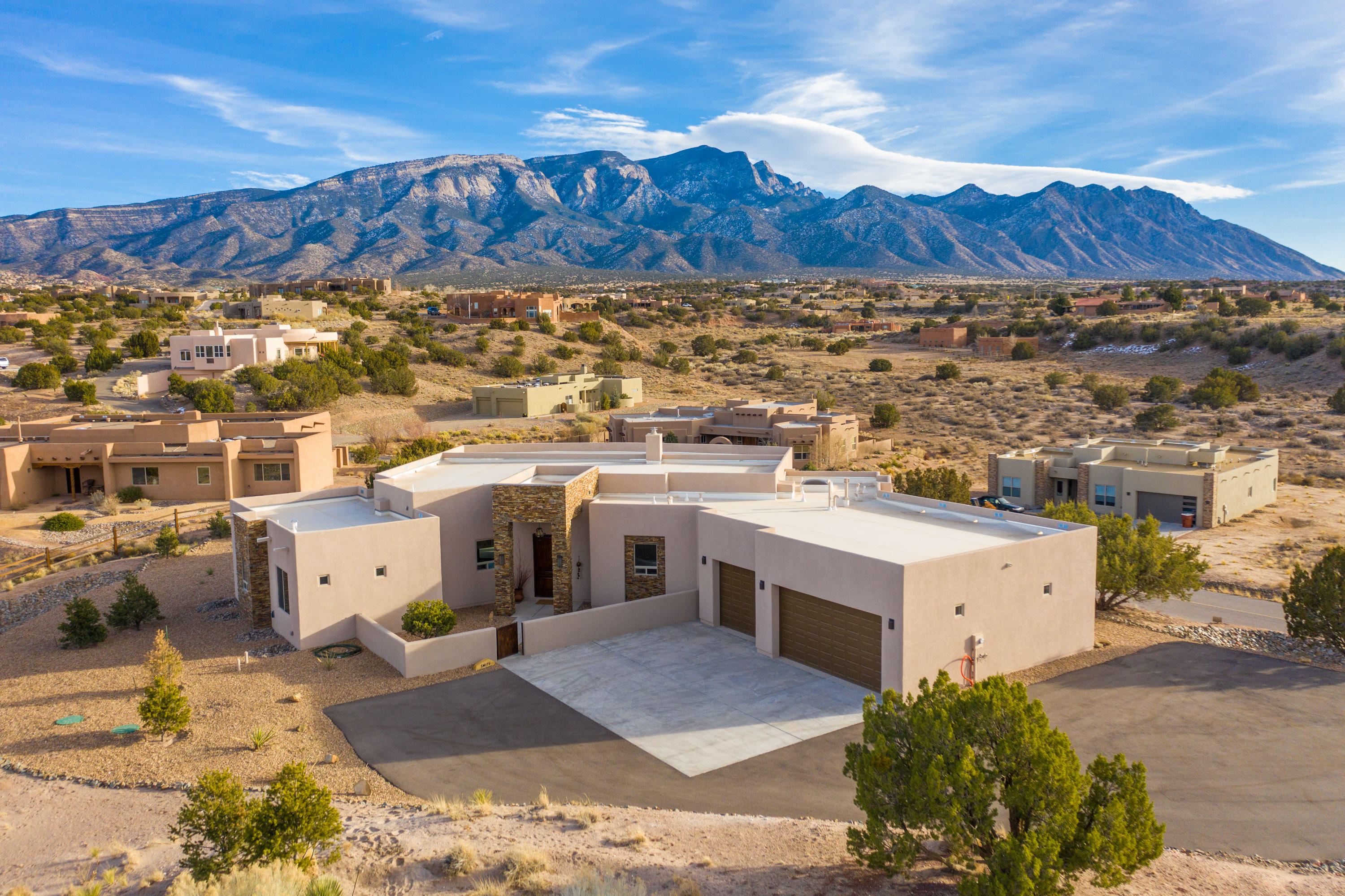 This single level custom home, located in the desirable Anasazi Meadows subdivision, showcases the incredible views of the Sandia Mountains! Great room concept with open kitchen, featuring: granite counters and island with breakfast bar, custom backsplash, GE Cafe appliances and large pantry. Completed in 2020, the custom amenities include: unique light fixtures, gas log fireplace, porcelain wood-look tile, solid wood doors, security system, Dreamweaver Reflections III carpet in the bedrooms & high end polyaspartic garage floors . The master suite has a large walk in closet with built-ins, and the spa-like en-suite bath features a dual vanity, large freestanding soaker tub and separate shower w/ dual entrances  Please click ''More'' for additional information about this incredible home . .