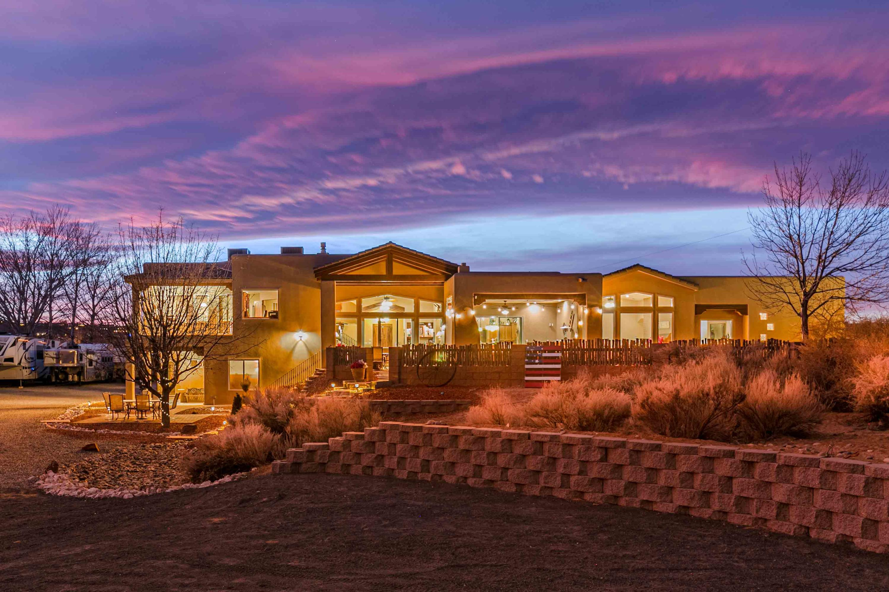This exquisite smart home is located on a tranquil cul-de-sacin Corrales. A sophisticated mix of traditional Northern NewMexico architecture with modern comforts. Soaring elegantwood ceilings welcome you into the spacious family room.Breathtaking views of the Sandia mountainsfrom the wall of windows invite you to relax in front ofthe fireplace. Gourmet kitchen located in the center of thehome, making entertaining a delight. Five covered patios, anincredible outdoor kitchen, and recent xeriscaping allow you torelax and take in the panoramic views of the Sandia mountainsand city. Luxurious master suite located on the main floor, dogspa, and artist studio/separate office reflect attention to detailthroughout the home.