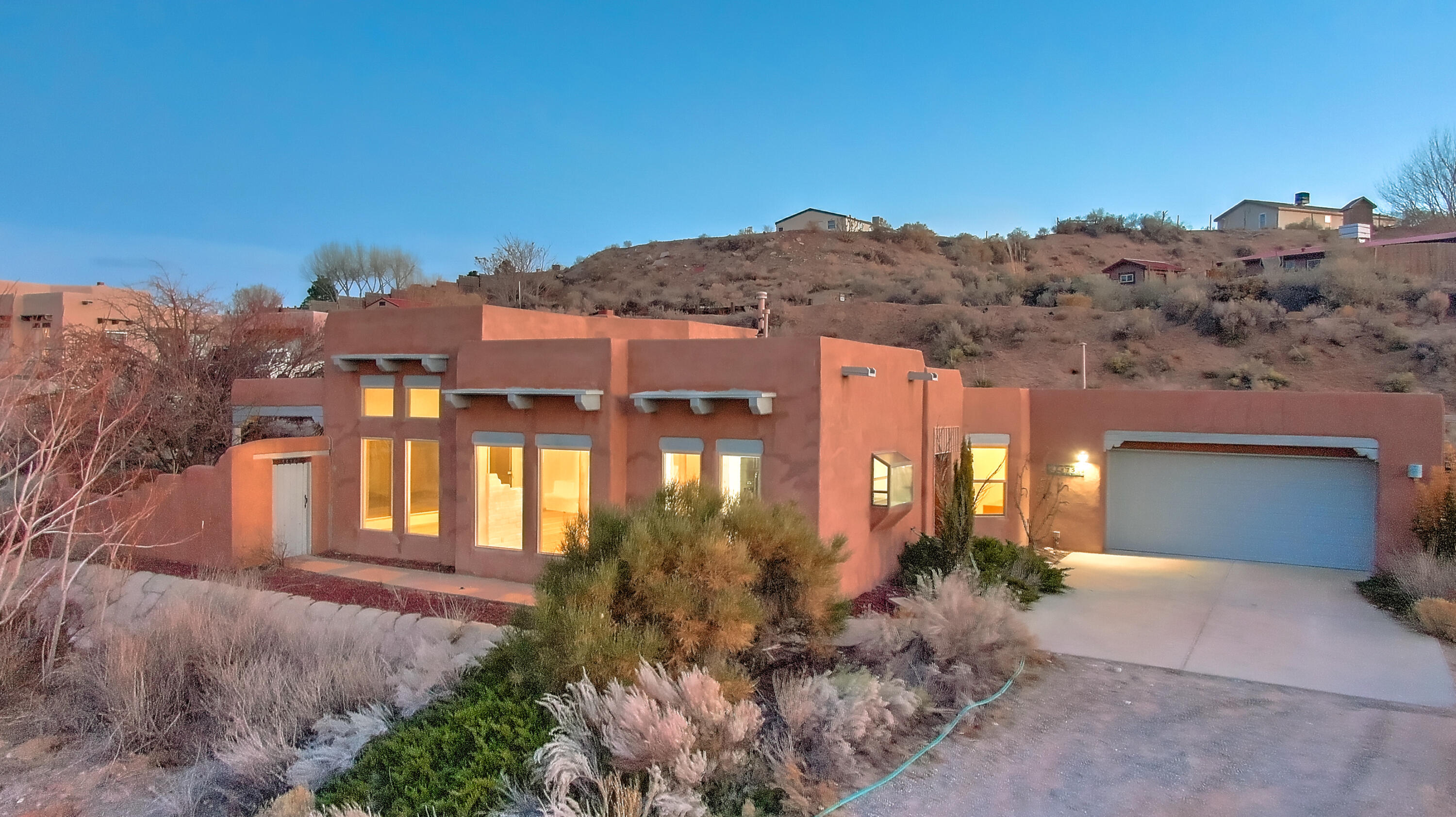 This beautiful Southwest style Corrales property is ready for a new owner. With over $12k in Jan 2021 improvements it is sure to please. Views of the Sandias are breathtaking. The privacy of this home is unparalleled.  Classic southwest style adobe and luxury wood viga ceilings capture the essence of the high desert.