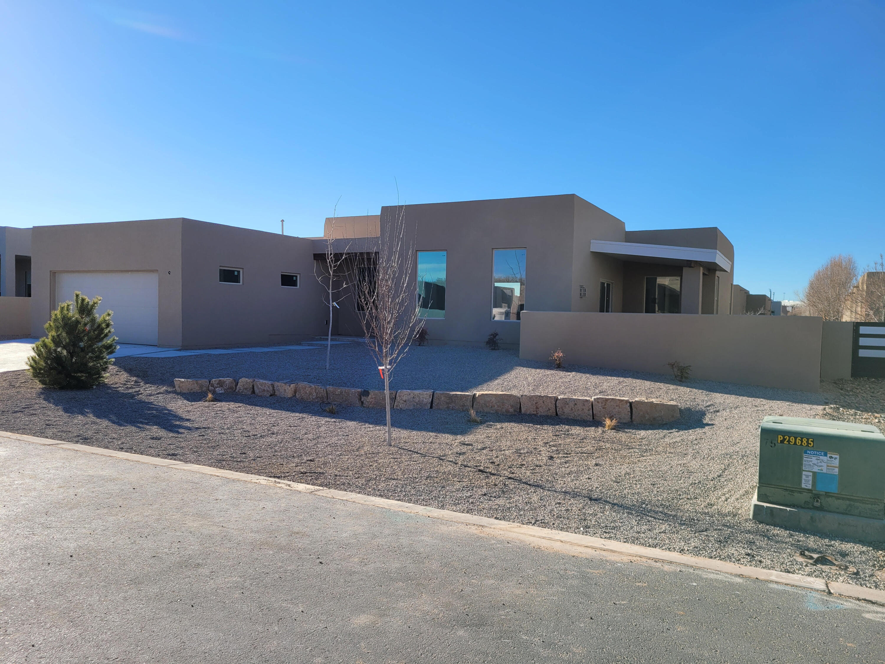 Beautiful new construction within the gated subdivision of Bosque del Rio Grande, with access to the Bosque and some of the prettiest views at every turn within the subdivision! This 2047sf home opens with the Greatroom/Dining areas with contemporary fireplace facing the generous Kitchen.  Gorgeous tile flooring throughout except for carpeted bedrooms.  On one side of the house is the large Owner's Suite with TWO huge walk-in Closets, and a lovely bathroom with walk-in shower and double vanity. The 2nd and 3rd bedrooms are on the other side, sharing a full bathroom. 2nd bedroom has double entry doors and a walk-in closet. Kitchen features a pantry and stainless-steel dishwasher, gas range with ss hood, and drawer microwave. Partial mtn views from front courtyard, OS bedroom, and greatroom!