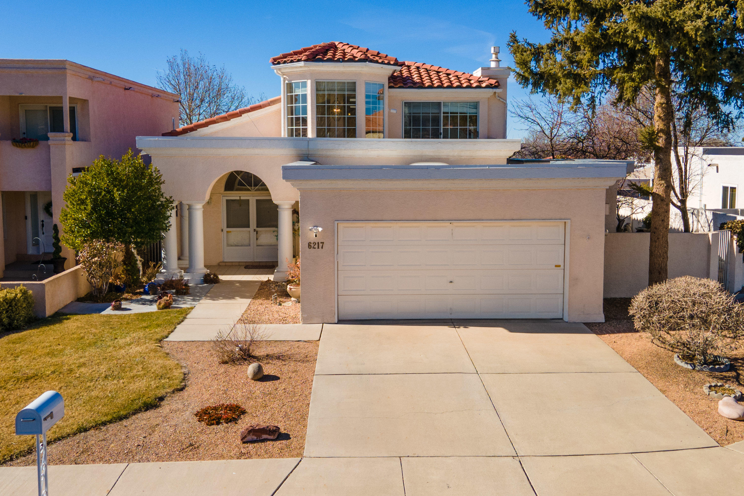 Highly sought after NE heights location with abundant SMART HOME features. Open loft/study with stunning views of the Sandias. Natural light from windows & skylights. Recently remodeled kitchen with granite countertops.Convenient to shopping & entertainment.  Additional space in garage perfect for workspace or storage.Backyard has pear, cherry, peach and apple trees. Pre-inspections completed and attached. Please see amenity list attached identifying all that conveys with property. American Home Shield 1-Year Warranty Included for Systems and Appliances (with an acceptable offer). All furnishings available for sale.