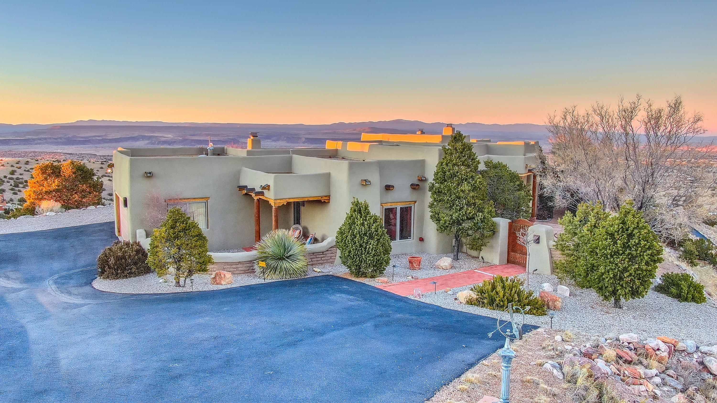 Placitas Pueblo Perfection! Exclusive Overlook subdivision w/dramatic east/west setting showcasing incredible natural light, world class vistas of the Rio Grande valley & mesas, Jemez & Cabezon mtns and the high desert hills that name the address. The summit of Placitas living inside & out adorned w/rich, authentic Santa Fe style & finishes. Built by master builder Ed Paschich and maintained w/huge pride of ownership with major updates/upgrades. One level excellence featuring attached guest qrtrs, mltple living & dining areas, real chef's kitchen and THEE master ste that will take your breath away. Outside boasts front & back private crtyrds, Kiva fp, cowboy kitchen, hot tub & two water features- never ending views everywhere! Incredible hacienda w/great access to I-25, shopping and more