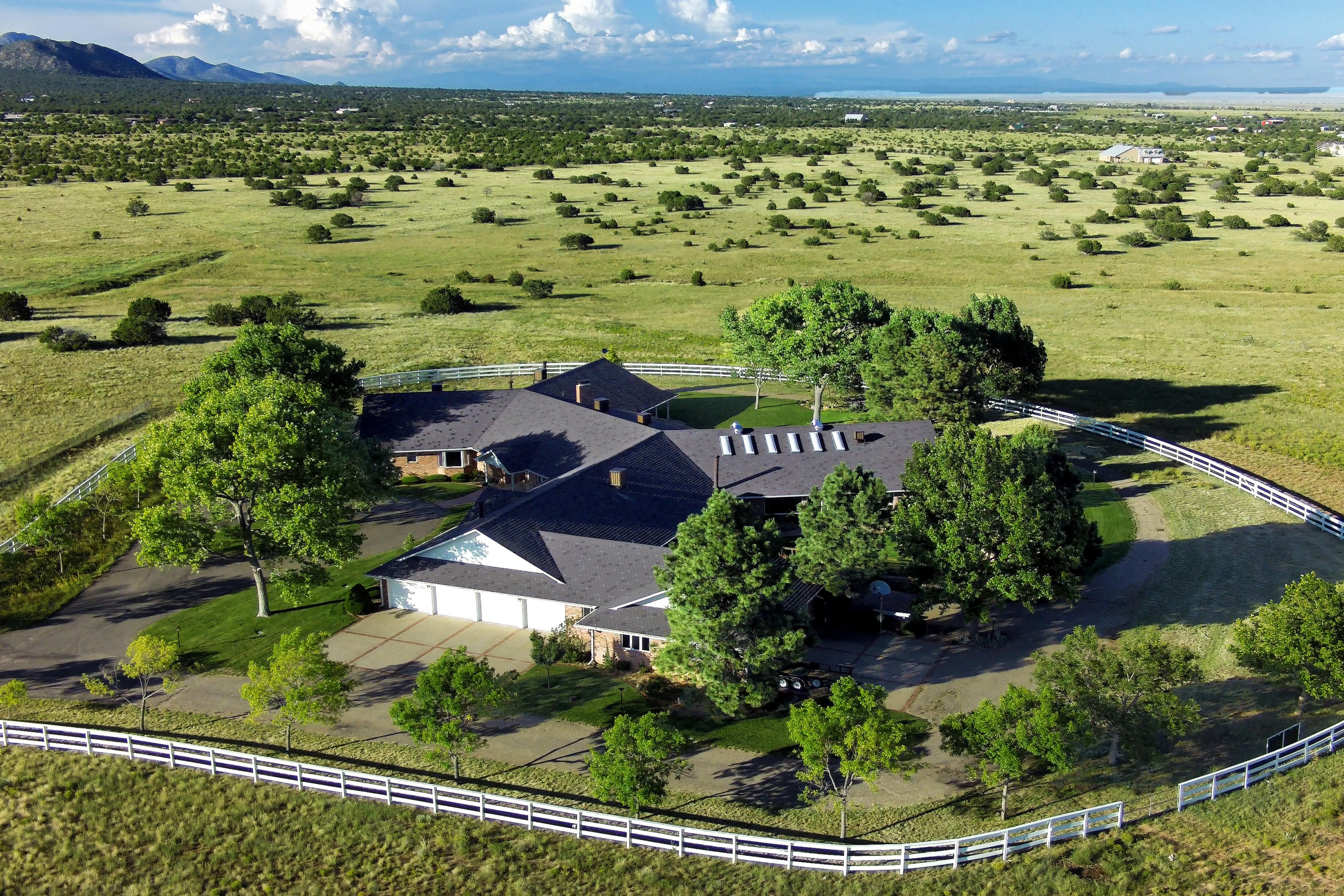 Where the mountains meet the Great Plains, this charming equestrian property know as The Starlight Ranch has captured the essence of the Wild West, 6 Bedrooms, 10 baths. Edgewoods Premier Executive Ranch Home, the entire property is on 85 completely fenced acres which include an 11,900 sq.ft. single-level bricked home with 7 heated, direct entry garages and 2 carports. Features include new solar panels; Elec bill is around $25 per month, Super Fast fiber high-speed internet, 2 septic systems, & a gated entry with a security system in place. Paved Tree Lined drive. A heated, indoor upgraded 20'x40' Gunite pool with Entertainment Dream Room. 4 Stall Barnmaster Barn with Runs & Arena. Would be an Excellent Bed/Breakfast Ranch. Make your dreams come true here!