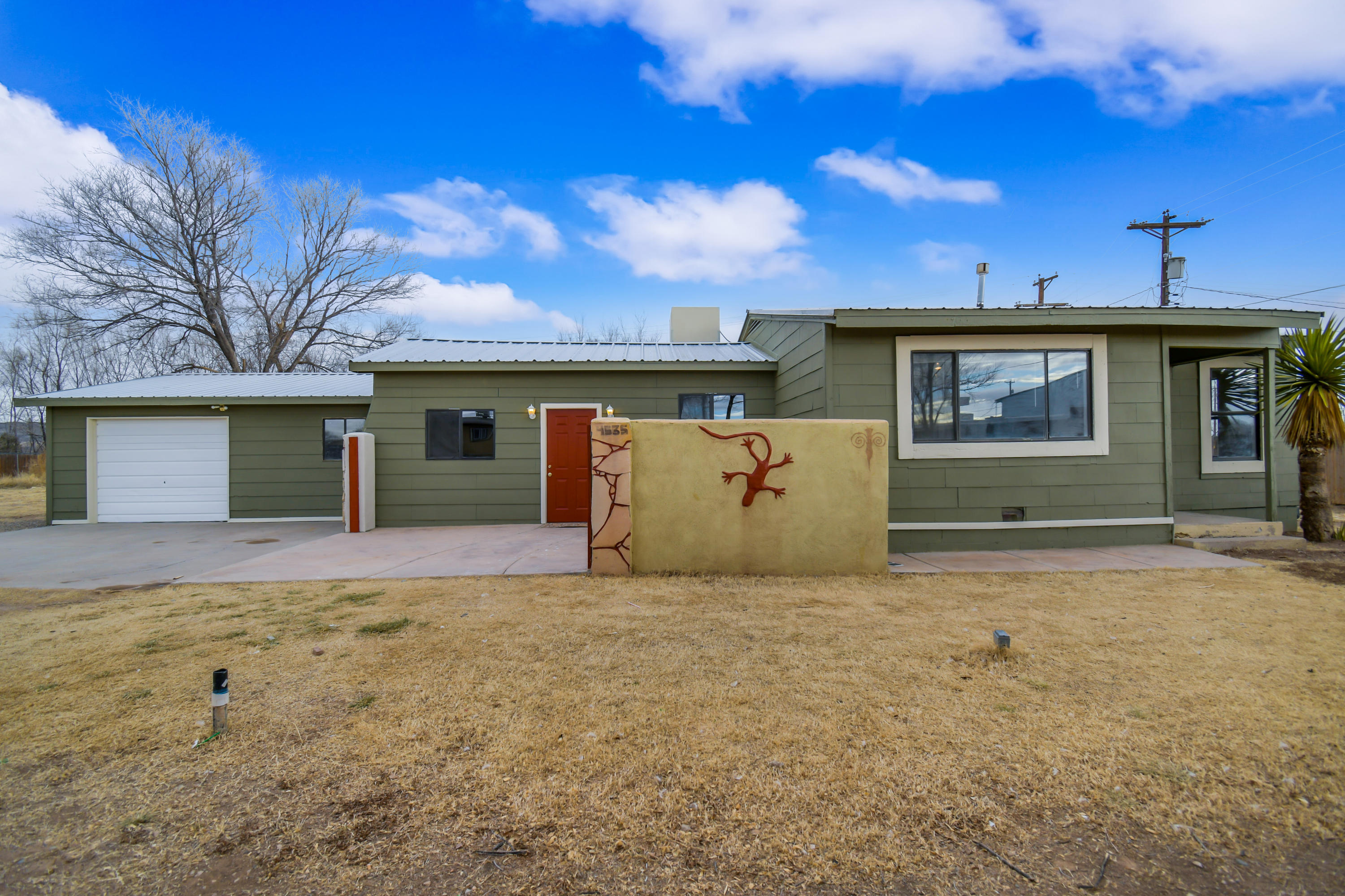 What a beautiful find on a 1/2 acre lot! Inviting entrance to this homey, open floor plan. Wood laminate flooring with carpeted bedrooms and a compact, easy to navigate kitchen! Large fenced-in backyard. Lots of potential inside and outside for the decorator in you! Schedule a viewing today, this one won't stay on the market for long!