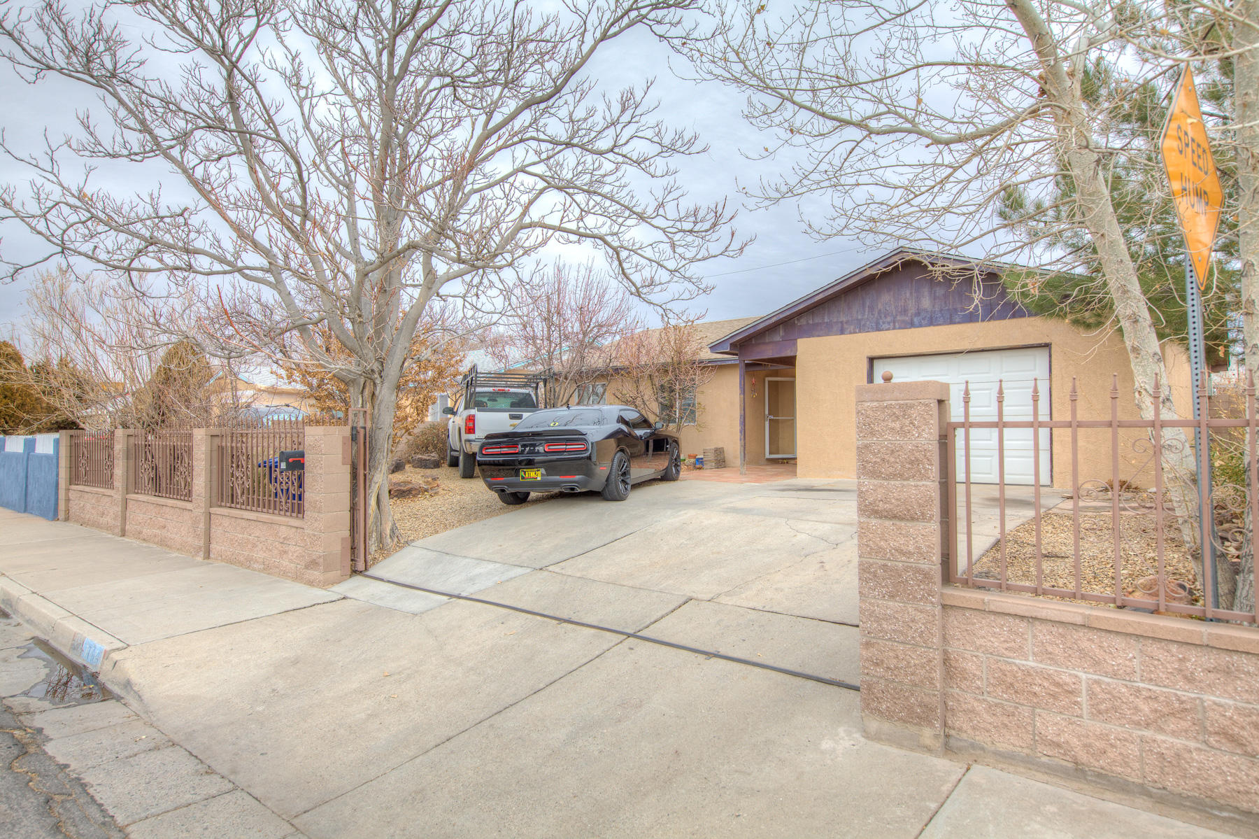 This home is fully fenced in the front and back for privacy. Tile floors throughout the home , no carpet. Granite counter tops add warmth to the kitchen.One Car Garage is oversized with a small workshop area.
