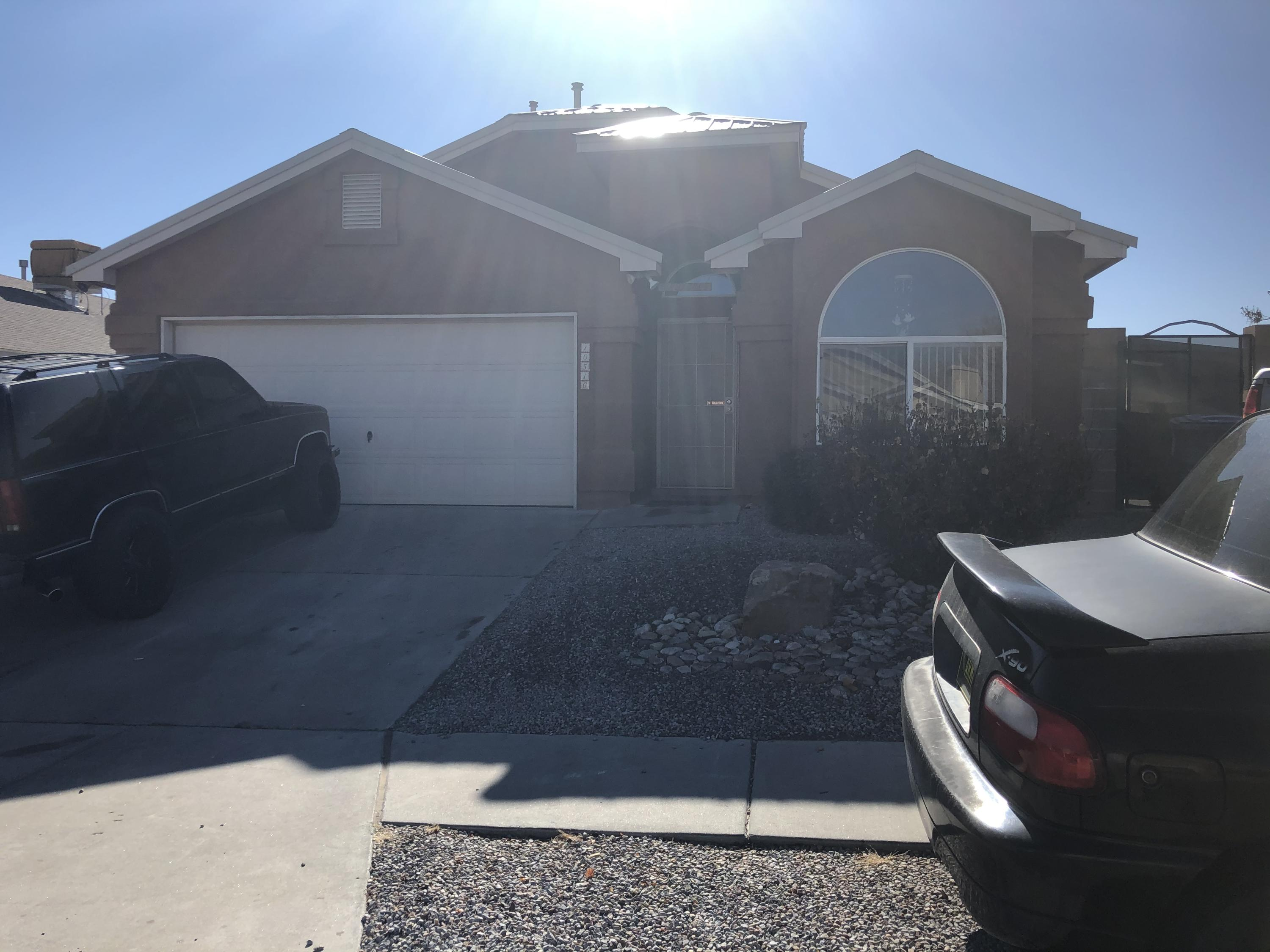 Beautiful 4br with custom tile, large covered patio with a bar.  Cathedral ceilings, kitchen island and an open floor plan.  Also this home features a block wall with backyard access.  It's a really great private yard with a gas grill and a sink under the covered patio. Shed does not convey.