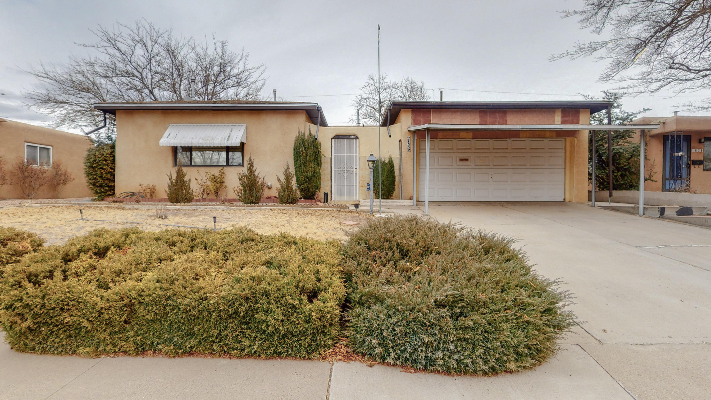 Great NE location in Snowheights neighborhood, close to Uptown, stores, freeway, restaurants, etc.  This is a 2nd owner home since 1960/61.  Perfect home for someone looking to put some ''sweat-equity'' into it to modernize it and make it your own! Private, security-door gated front entry courtyard has one open wall to garage area. Tongue & groove ceiling above front entry. Great floorplan and square footage (1865 sq.ft.) for the neighborhood!  Two living areas plus a SUNROOM, not included in square footage.  Front family room facing street has pellet stove, and a large living room opens to sunroom, with French doors to backyard. Large laundry area. Private backyard features shed with shelving for storage.  Roof is less than 5 years! Come take a look and this just might be your home!