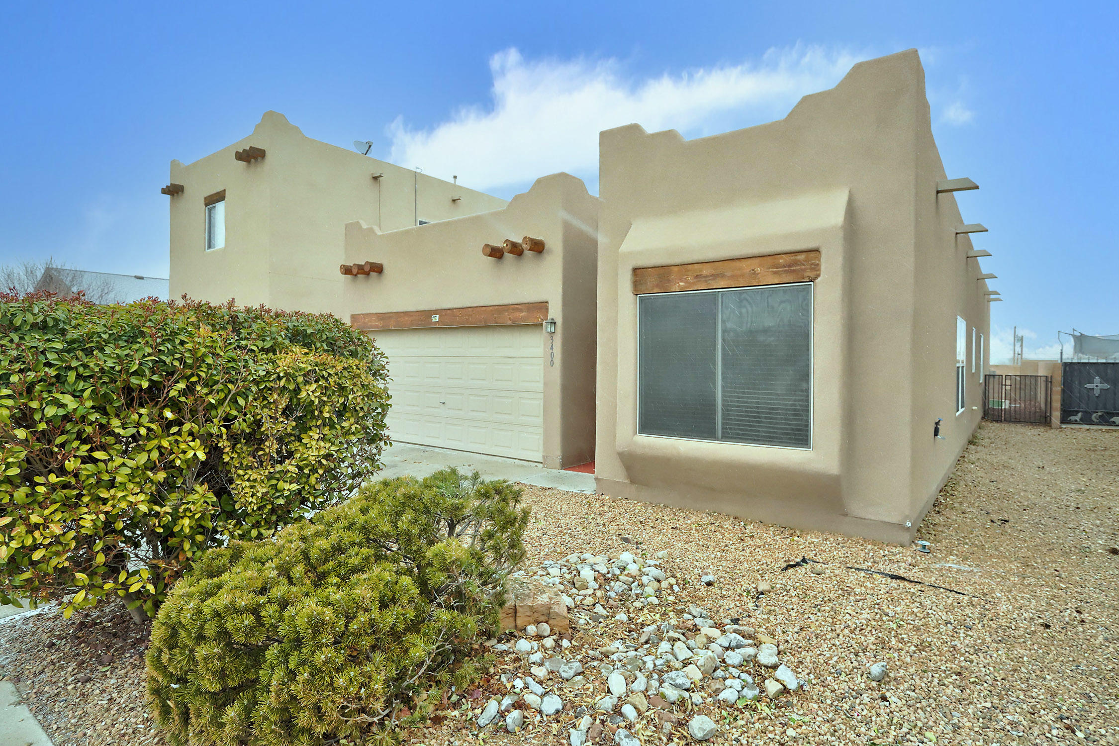 You're not going to want to miss out on this beautiful and spacious home! This one has a breathtaking view of the Sandias, stone countertops, refrigerated air, a warm and cozy fireplace and is complemented by the finished backyard with artificial turf making your backyard oasis easy to maintain. Don't miss out on your opportunity to call this one yours.