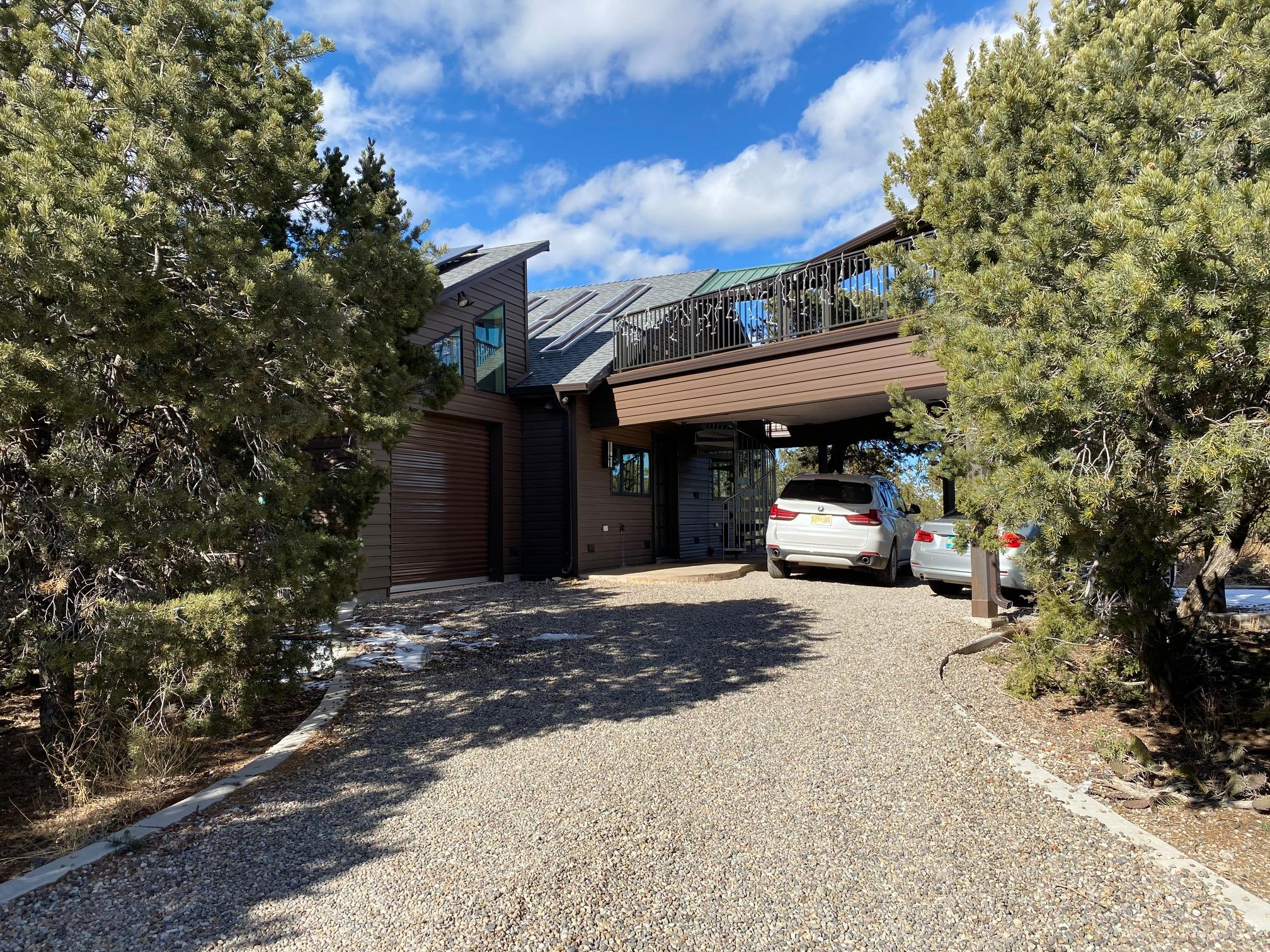 This unique, custom home on 7.5 acres is a one of a kind find. Private, gated subdivision, 3 total lots make up the 7.5 acres. Entranosa water,passive solar  water heater,  radiant floors, and a two way custom gas fireplace.  4 unit Carrier split system also for heat/and ac. Garage is insulated and finished, heated and cooled. Sub zero refrigerator and wine cooler, two built in Miele ovens, lots of direct and indirect lighting. Natural stone tile floors, plastered walls.  Custom trex deck with 360 degree views.