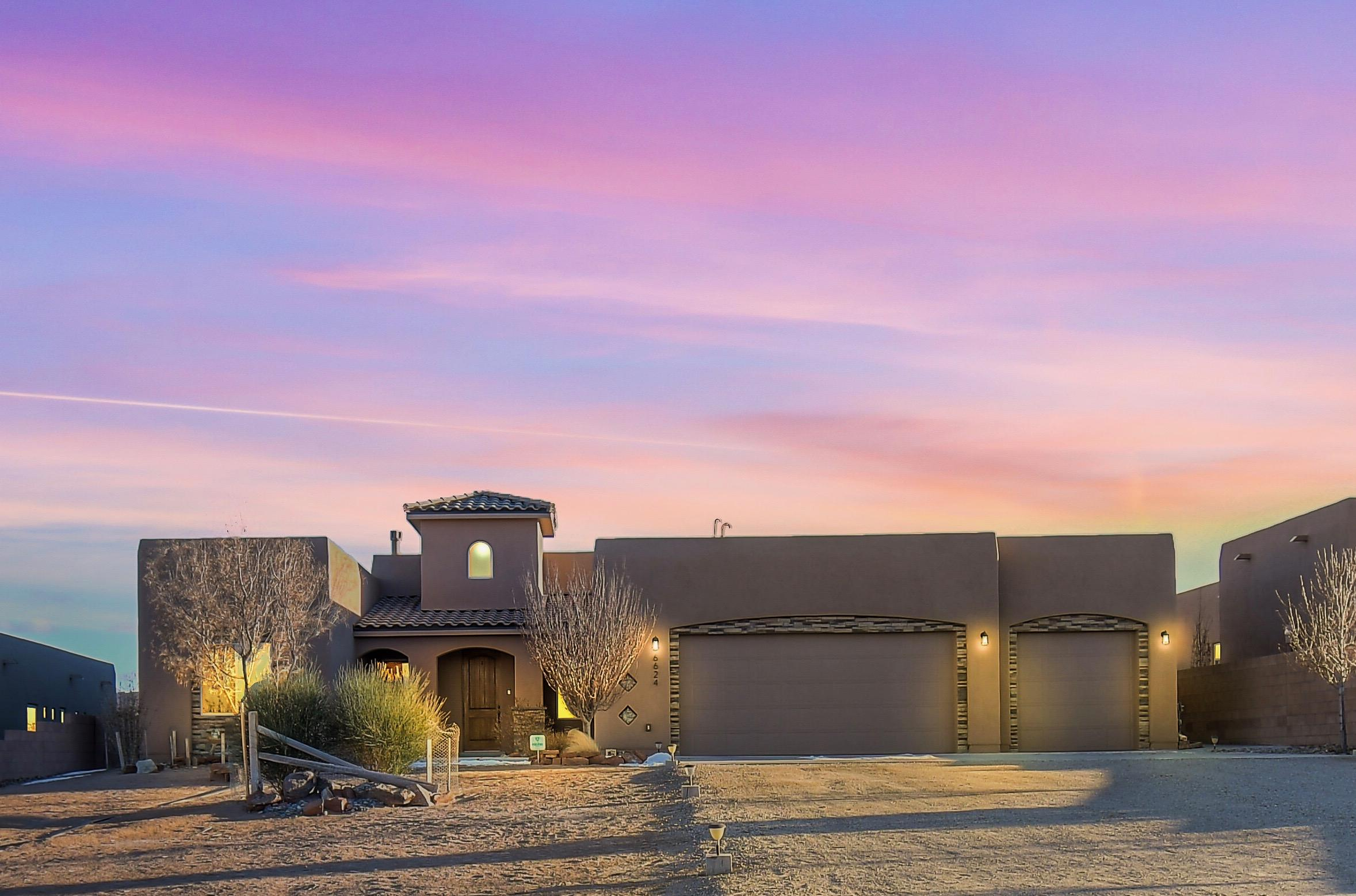 This Custom Home in Rio Rancho is something you do not want to miss! 3 Bedrooms and 3 Baths sitting at 2235 Sq.Ft. The Master Bedroom Has Breathtaking view of the Sandia Mountains, Large walk in shower, Luxurious Bath Tub, Double Sinks and Vanity Area to get ready! Spectacular Walk in closet that is adjoined with the laundry room for convenience. The Kitchen is Great for Entertainment and a Chefs Dream with Gas Range and plenty of storage. 4 Car Garage with beautiful custom wood storage lockers. Includes a Broan Air Filtration System and water softener system.  This Home is LEED-gold Certified. Schedule a showing today!