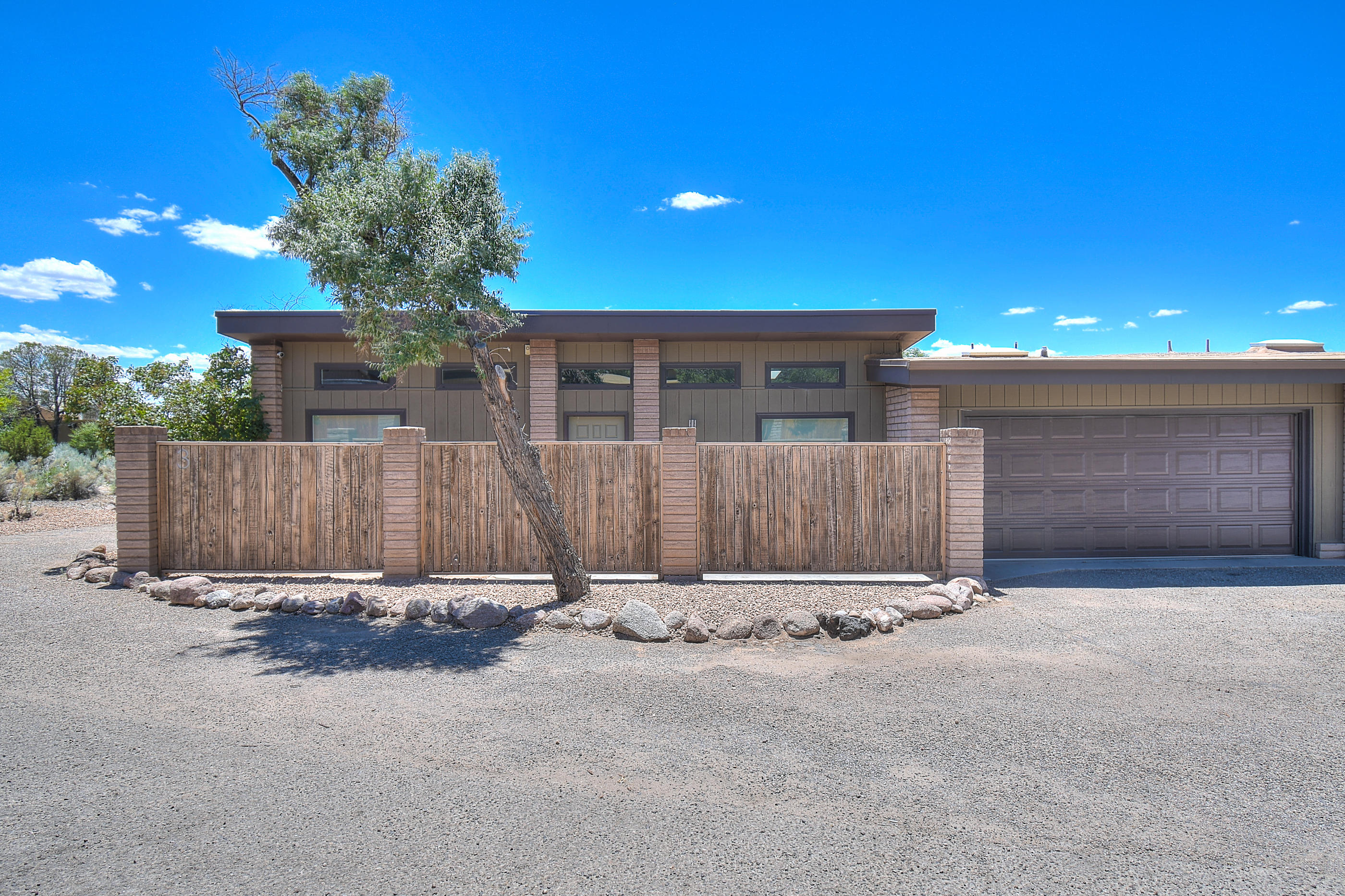 Spectacular Town Home In Sandia Heights! Don't Miss This Modern Hidden Gem Right Next To The Mountains!The Incredible Floor Plan Offers 2BR,2 Full BA,Updated Kitchen, Designer Paint,Custom Light Fixtures,Newer Owned Solar,Ref Air,2CG, And More! Enter The Pleasant Court Yard W/Mountain Views, And Into The Light And Bright Open Concept Kitchen And Living Room With Gracious Windows & Tons Of Natural Light! The Kitchen Has Updated Modern Cabinets, Eat In Counter/Island, Newer Flooring, Electric Range, Dishwasher & Microwave, And Plenty of Counter Space To Work With! Escape Into The Impressive Master Bedroom With Full Master Bath, And A Spacious Walk In Closet Or Bonus Area. Second Bedroom To Follow And Full Guest Bath!So Many Amenities In This Home, And Close To Shopping And Restaunts!