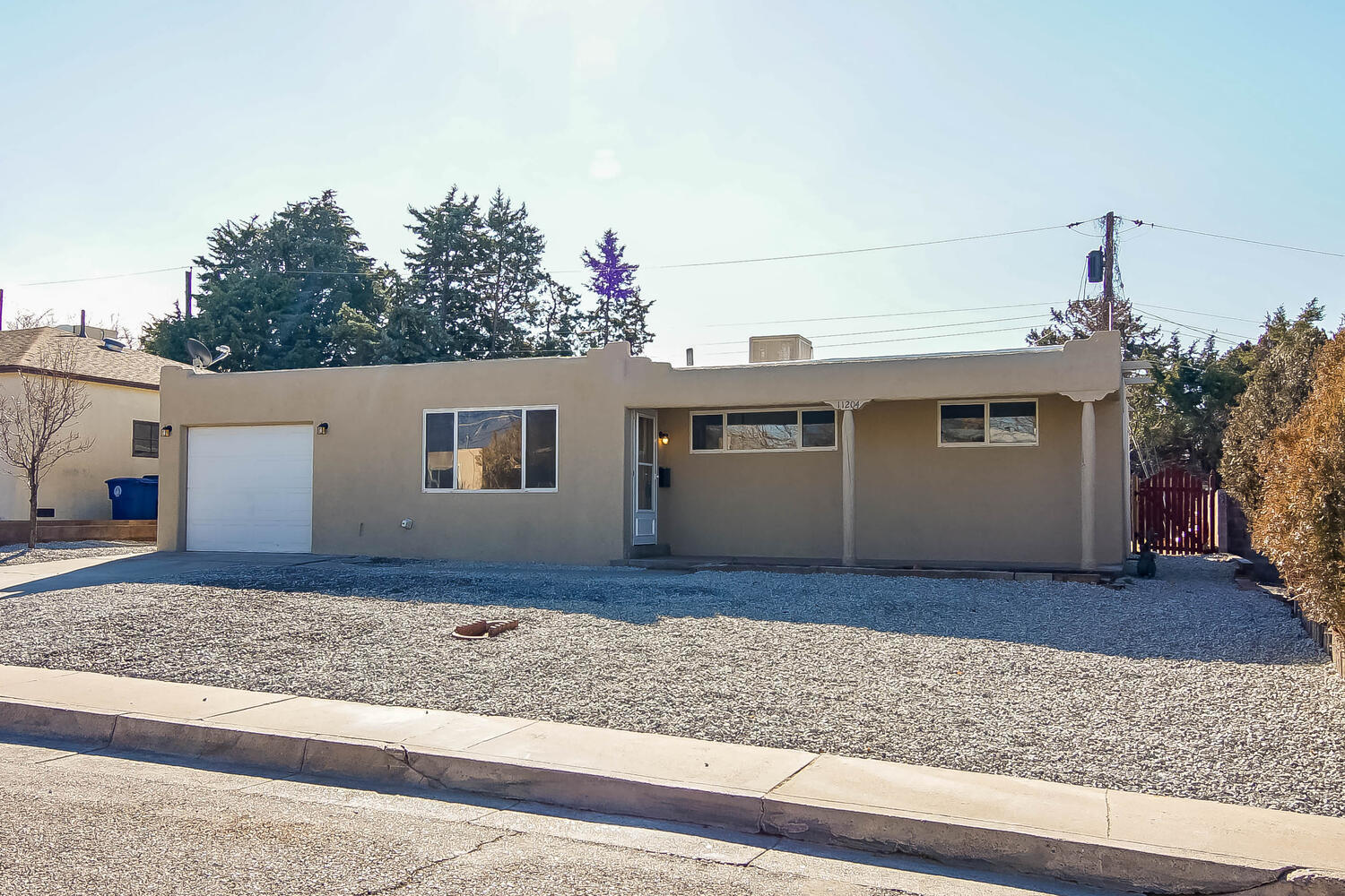 Amazing opportunity in the NE Heights! All NEW IN 2020 & 2021:  New gas furnace, new doors, new laminate flooring, new stainless steel kitchen appliances, new kitchen cabinets, new granite counter tops and new tile & vanities in both bathrooms!  New TPO roof & hot water heater in 2018.  Transferable roof warranty. Enjoy the two living areas & wood-burning fireplace.  No carpet.  Master bedroom has an en-suite 3/4 bath.  See this beautiful home today!