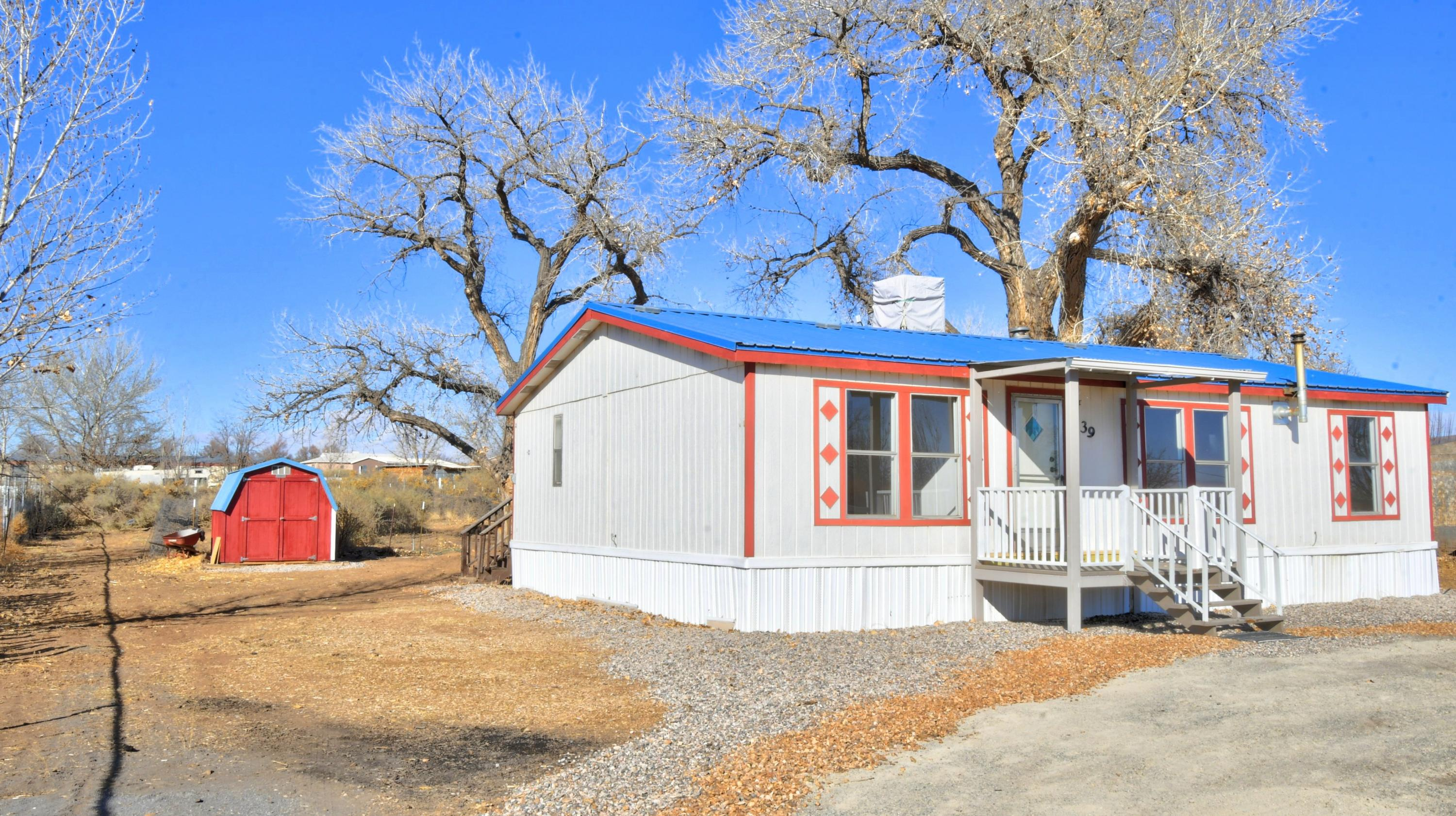 Country living convenient to town! Come see this sweet manufactured home on a fully fenced half acre. Bright, open living room and kitchen, two full baths, two storage sheds, deck, updated appliances, freshly cleaned and painted and ready to call home! Shared well with friendly neighbors!
