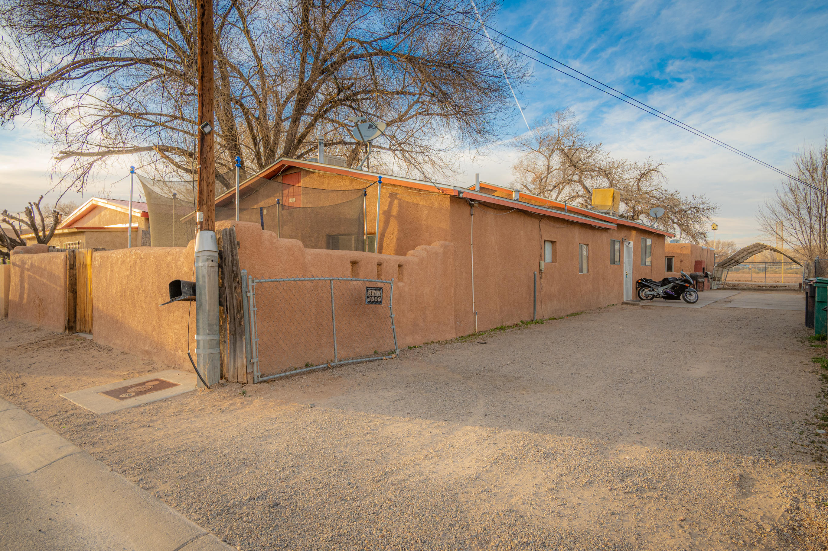 South Valley property with 2 Houses! Income generating property! Both houses are currently rented and separately metered. Please do not disturb tenants. We will arrange a showing with an accepted offer.