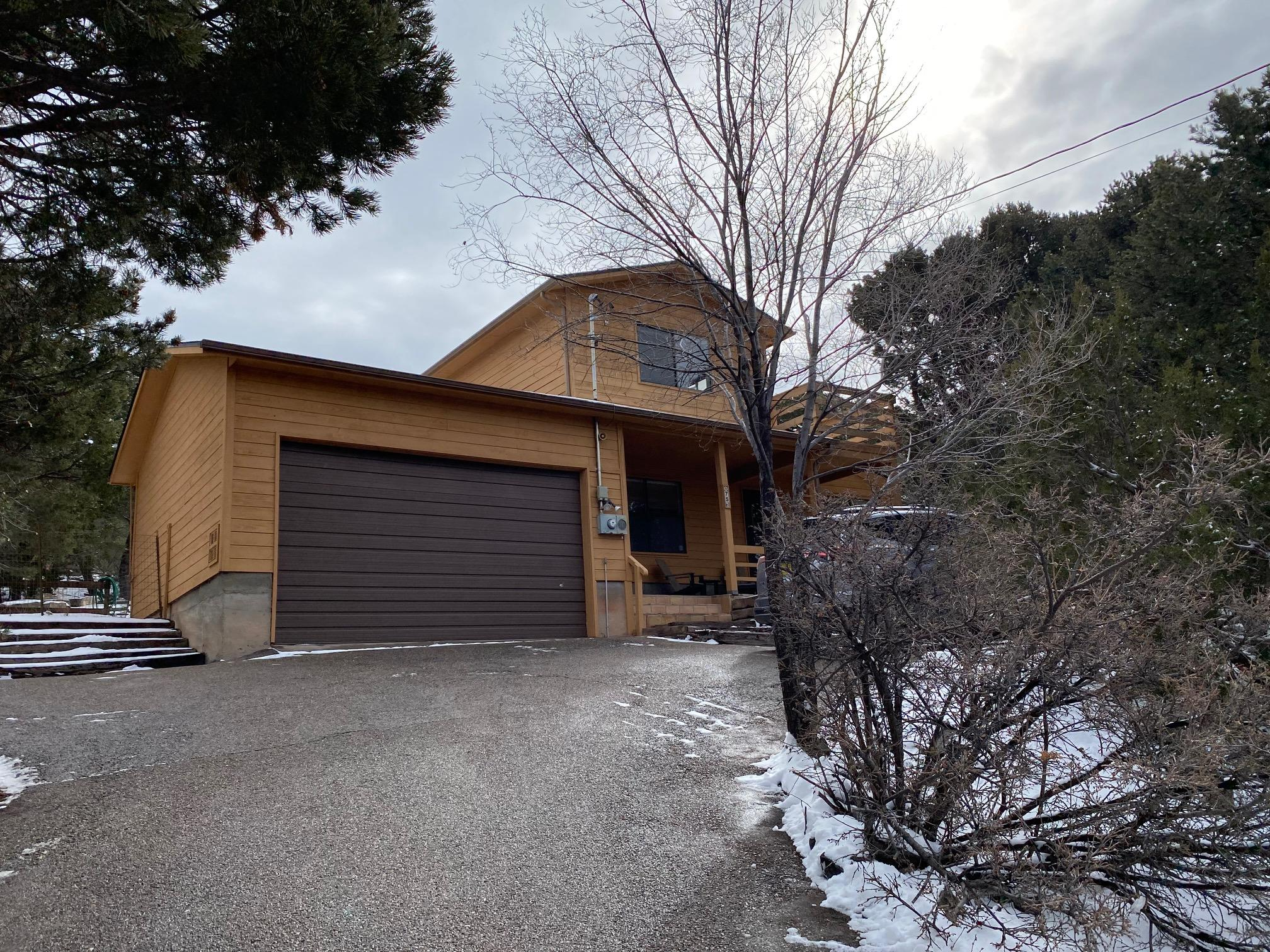 Lovely mountain home that just might check all your boxes.  Views-wooded- brick floors- bright- wood stove-tongue and groove vaulted beamed ceiling-2 car garage-paved road- asphalt driveway-patio-southern exposure.  This charming home had a new roof in 2020, water heater in 2017, exterior stain and interior paint in 2017, new well pump and equipment in 2016.  Move in ready after March 31.  Hurry, won't last.