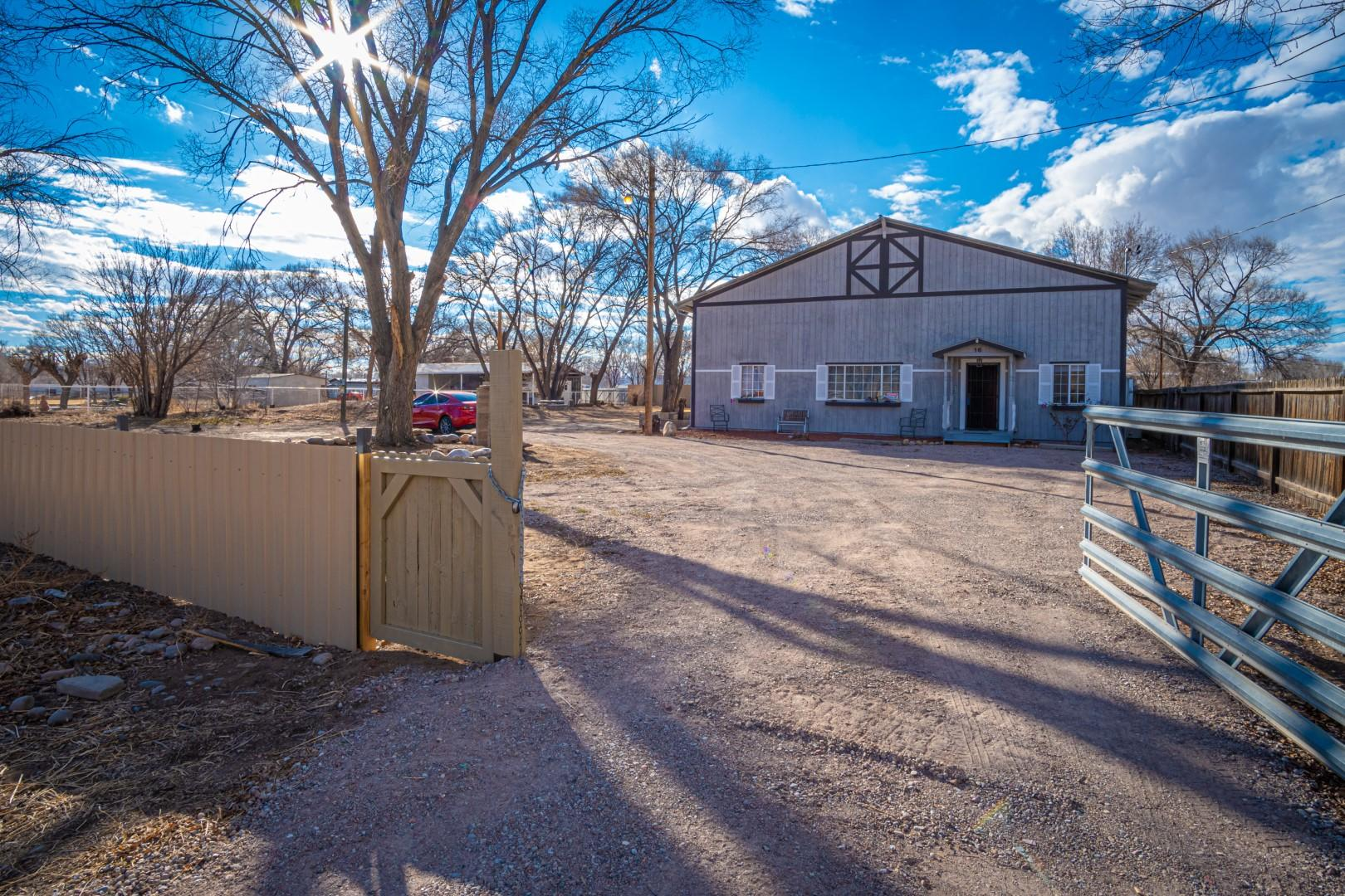 Beautiful remodeled home nestled on  .75  acres in Peralta.  This  5,028 sq ft. home is located in country setting & features 5 bedrooms (possible 6) with 2 full, baths, 1 3/4 bath + 1 half bath.  Spacious open floor plan with 19x31 combo great room w/cathedral ceilings, pellet stove & brick feature wall.  Kitchen has island/breakfast bar, solid surface counter tops, white Shaker cabinetry, pantry & stainless steel appliances.  Master Suite located on the main floor features walk-in closet and spa bath with garden tub, separate shower & double sinks.  Extra wide hall ways &  wide-plank hard-core vinyl flooring throughout the home. Completely fenced  & RV hook-up.  Private well and natural gas.  Will be connected to city sewer.  Easy access to Albuquerque & close to all City conveniences.