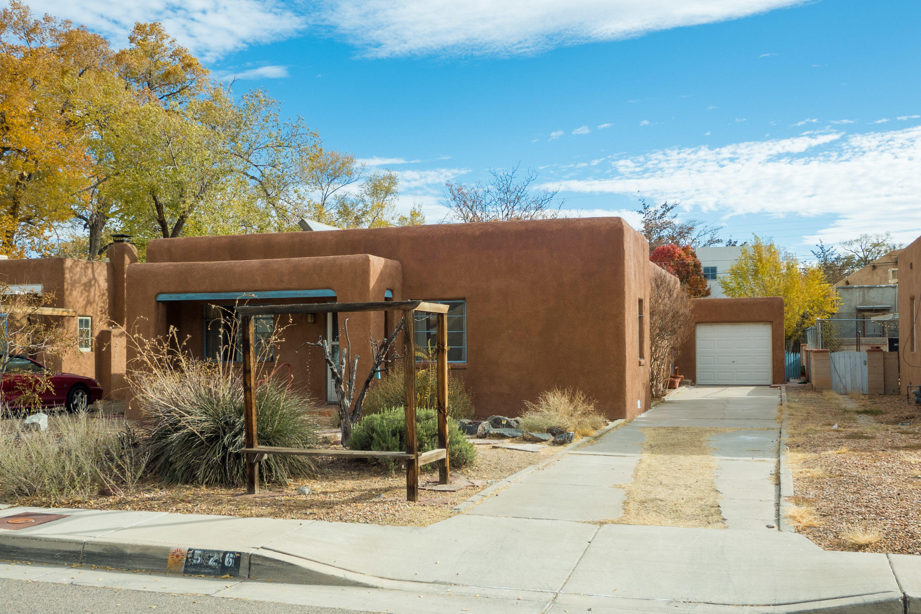 Great location for UNM or UNMH, 3 bedroom and 1 & 1/2 bath charmer has a one car detached  garage .  Original oak hardwood floors in the living room and bedroom and new carpet in other bedrooms and hallway. Refreshly painted interior.  Natural landscaping front and back.*some photos are virtually staged*
