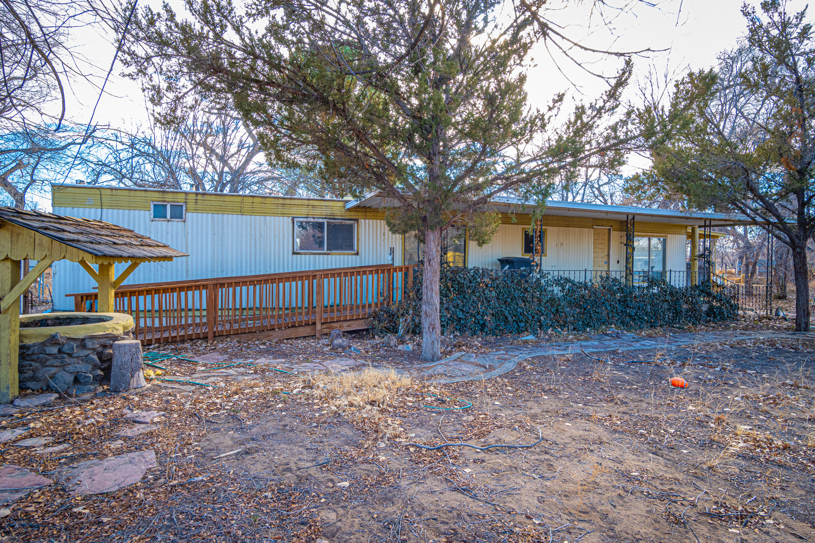 Great opportunity for the investor!  This 1971 Santa Maria Manufactured Home was built with 2x4 construction.  Now it just needs someone to come in and make it grand again.  It's a blank canvas and sits on a .50 acre lot.  Three bedrooms, two bathrooms, two spacious living spaces with a formal dining room.  The living room addition walks out onto the deck overlooking the backyard.  In the backyard you'll find a couple out buildings for storage, garden shed or a ''he/she shed''.  The front yard has flagstone landscaping under the tall grass.  Don't miss out on this opportunity, schedule your appointment to preview today!