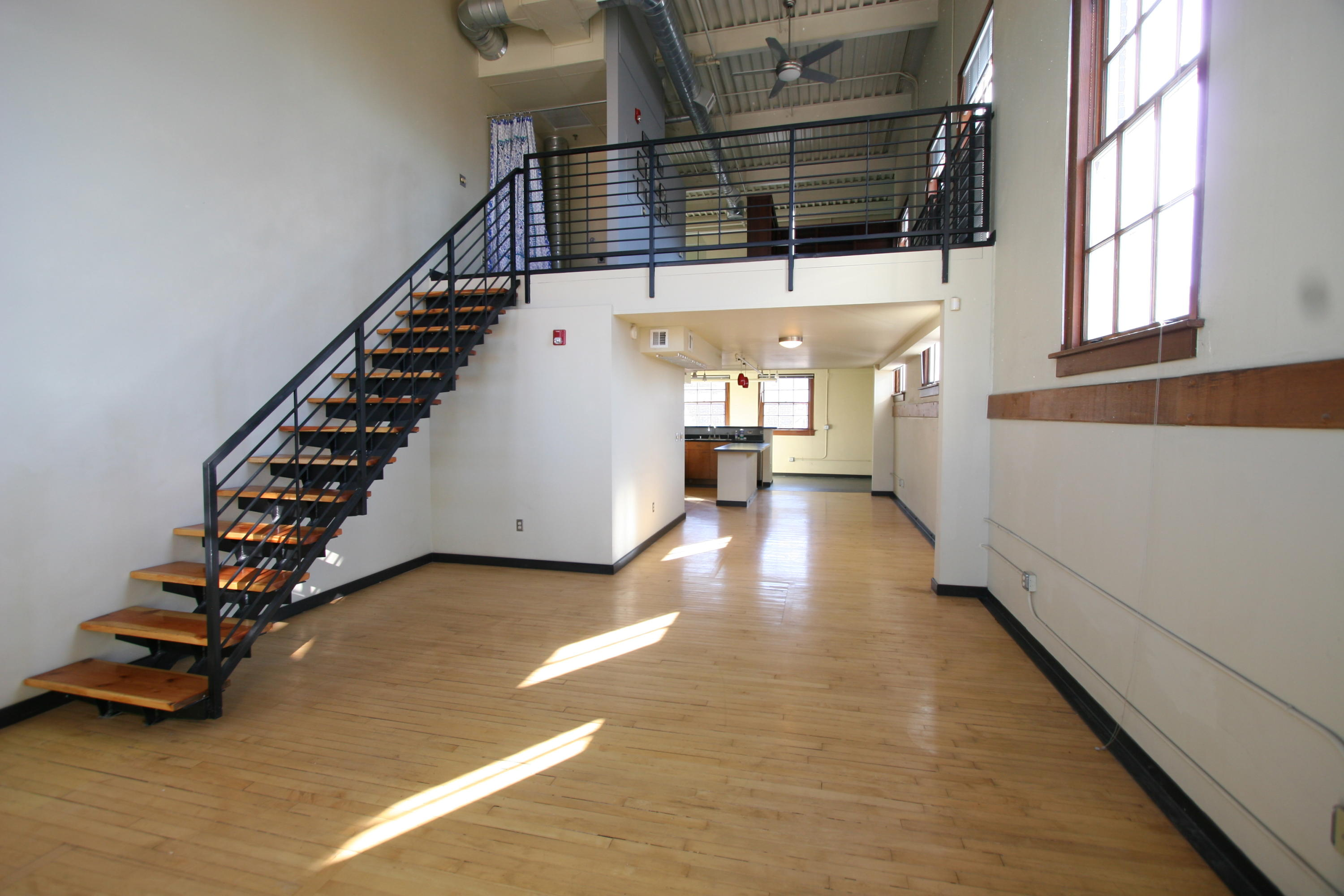 Located in the 1938-built historic Gymnasium building at The Lofts at Albuquerque High in East Downtown (EDo), this loft is the largest in the building. Located at the northwest corner, it features an island kitchen, original wood floors, elevated ceiling, west- and north-facing windows with mountain and downtown views, spacious full bath and 3/4 bath. Access to beautifully landscaped secure courtyard with grill, fountains, seating. Secure building. Common lobby area. Secure parking available at City-owned garage across the street at 100 Arno Association dues cover water/sewage/trash/recycling, insurance, common area maintenance, reserve contribution. Airbnb not allowed.