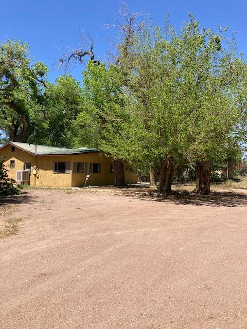 1296 SqFt 1 bedroom 1 bath home on 1.79 acres. With ditch irrigation for 0.98 acre. Home features large family room and dining room. Plus bonus room that could be used as a second bedroom, den or home office . Large, 45 x 32 garage/workshop with built in storage. Home is on city water and sewer. Home is not currently hooked up to propane. Kitchen sink, dishwasher and clothes washer are plumbed as a grey water source to the yard on the north side of the house.