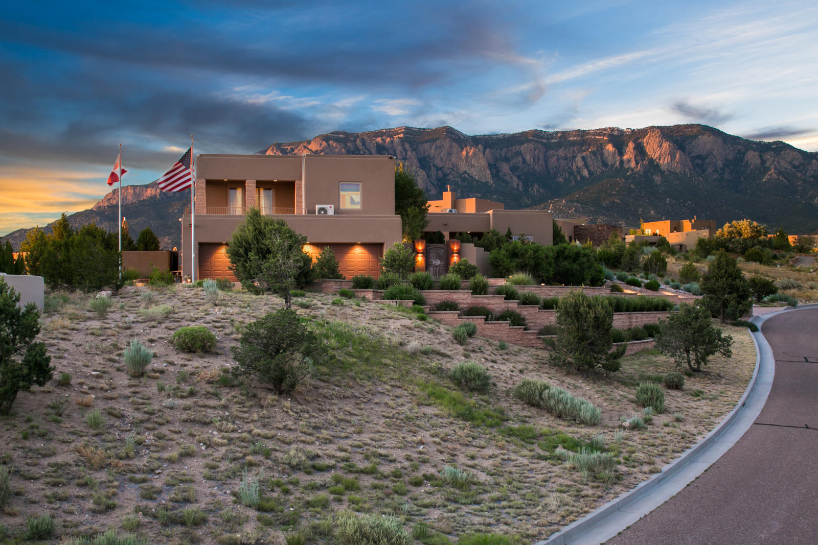 With breathtaking 360-degree views and tasteful attention to detail and quality, this is an exceptional jewel in the midst of the Land of Enchantment. Set between the rambling vistas of Bear Canyon and the towering majesty of the Sandia mountains, this home has been extensively remodeled with an elegant mix of Southwestern and European style. An eye-catching kitchen in white with handpicked Alpine Granite, top-of-the-line appliances, and a striking center island by a known artist. The outdoors inspire with a wrap-around flagstone patio, beautifully designed landscape with pinons, and a grassy area with a stone sculpture garden. 5 min. by foot to the trailheads; by car, it's 20 min. to the airport and Old Town, 10 min. to Whole Foods and private school Abq. Academy, and 50 min. to Santa Fe.