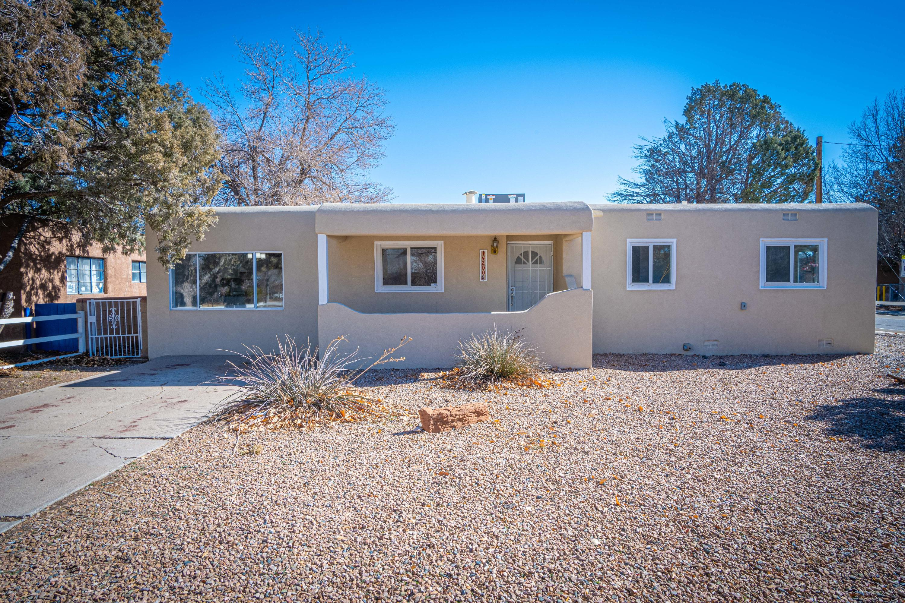 In the HEART of the North Valley you will find this beautiful and completely remodeled home which sits on over a quarter of an acre! This home features all new cabinetry, granite counter tops, lighting and tile throughout! In addition you will find a new TPO roof, new central refrigeration air and heating, synthetic stucco, 50 gal water heater, not to mention all new plumbing and electrical throughout the home.  For convenience, the backyard access will lead you into this amazing yard which has plenty of space to house your toys, to entertain or just sit and relax.  The workshop wired for 220 can be used for different things such as a studio, playroom or just storage. Your options are endless. Schedule a showing today!