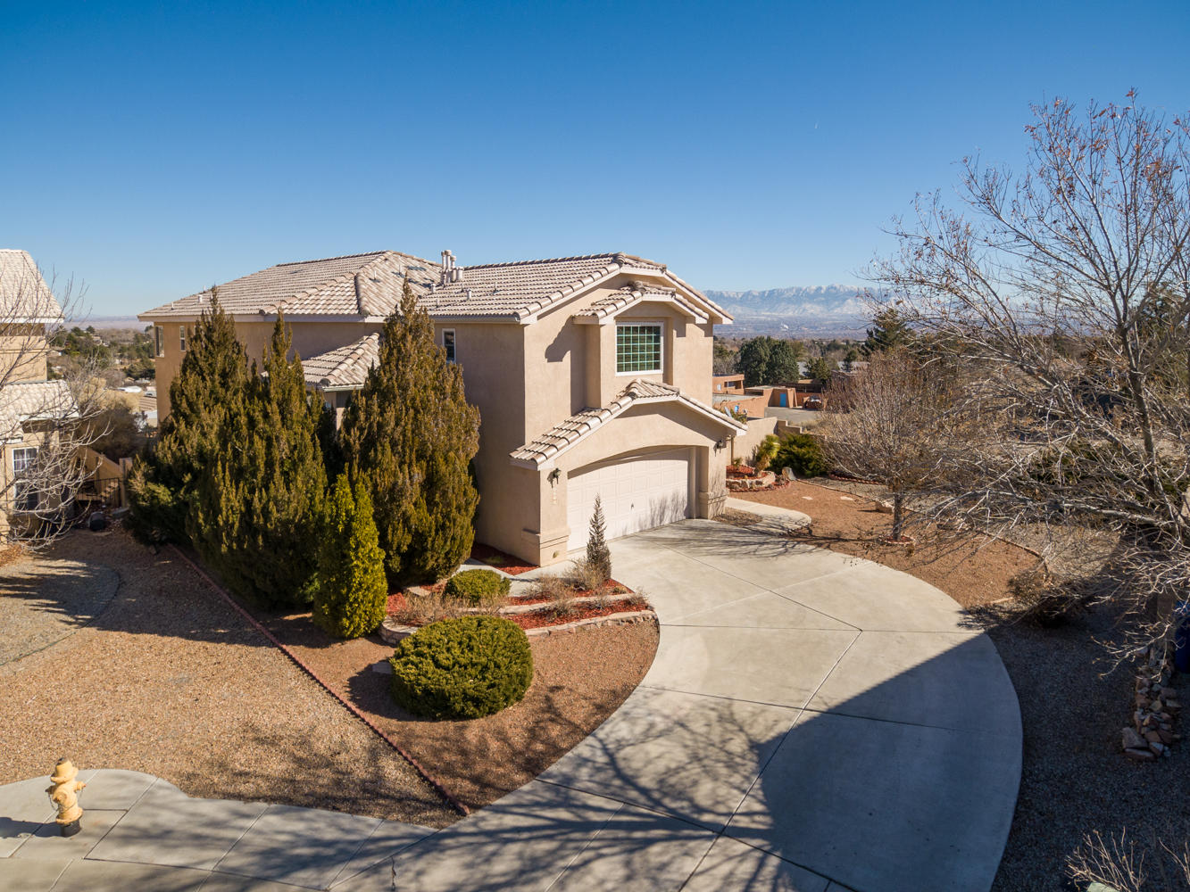 Stunning Paradise Ridge Home situated on a great culdesac lot w/unobstructed CITY & MOUNTAIN VIEWS! Showing better than a model, w/over $85K in updates & meticulously maintained, this home will not disappoint! A grand entry boasts a regal staircase & leads to the open & bright main living space w/energy efficient Anderson windows (2017), thoughtful corner fireplace, opening to the upgraded kitchen w/fine appointments including custom light fixtures; gorgeous granite counters; SS appliances; lots of cabinet space/pantry; & nook. Upper level features 2nd family room; Master retreat has private balcony & luxurious remodeled en suite w/huge walk-in closet; three addl bedrooms, one being a 2nd MBR! Enjoy low maintenance landscaping outdoors w/covered & open patio spaces, & relaxing hot tub.