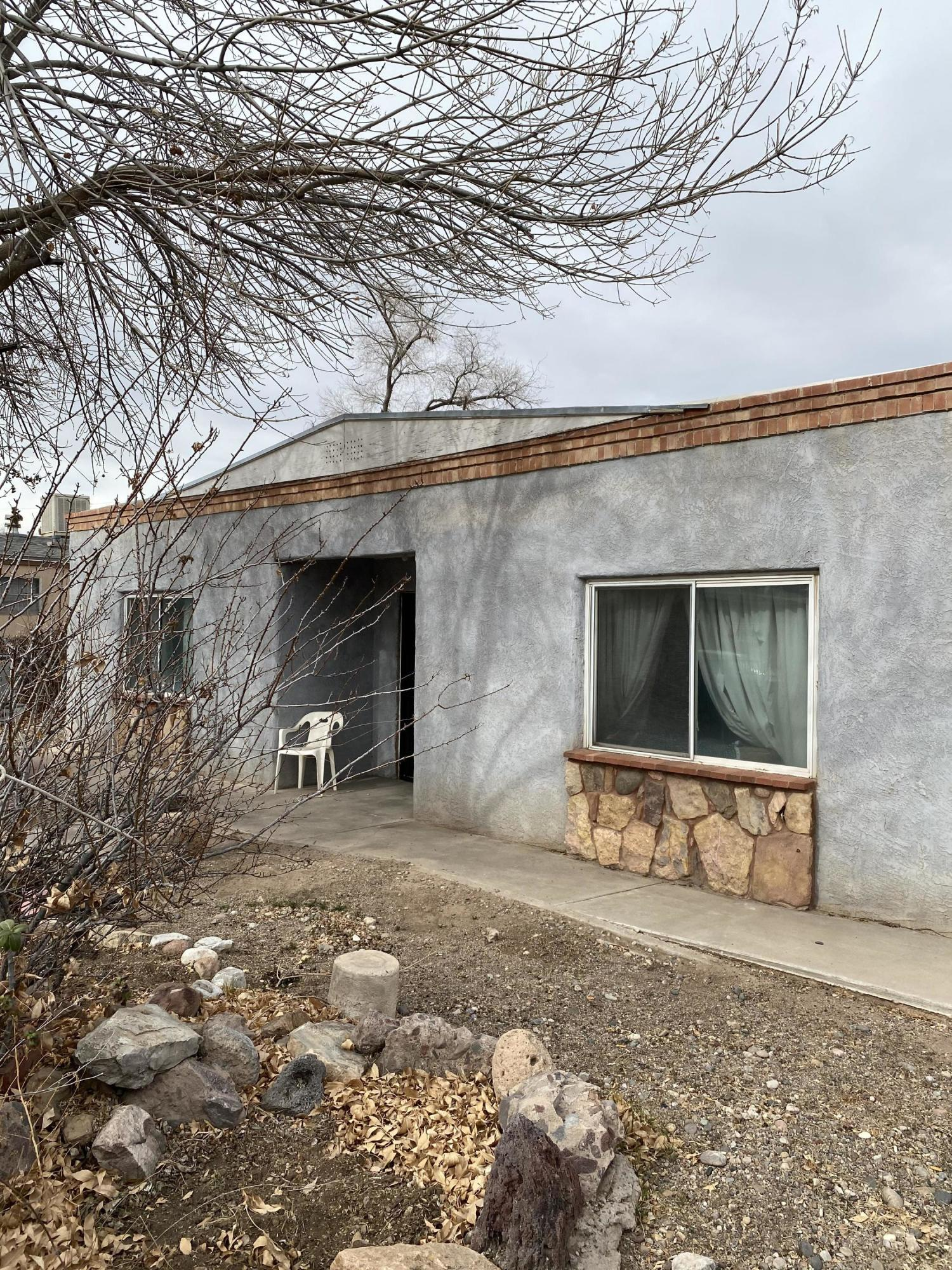 Clean solid livable fixer upper.Never been a rental.Backyard access.TPO roof about 6 years old.Hardwood under carpets in living room, dining room and hallway.Good sized Bedrooms.One Bathroom. Formal Dining room.Good sized living room too.