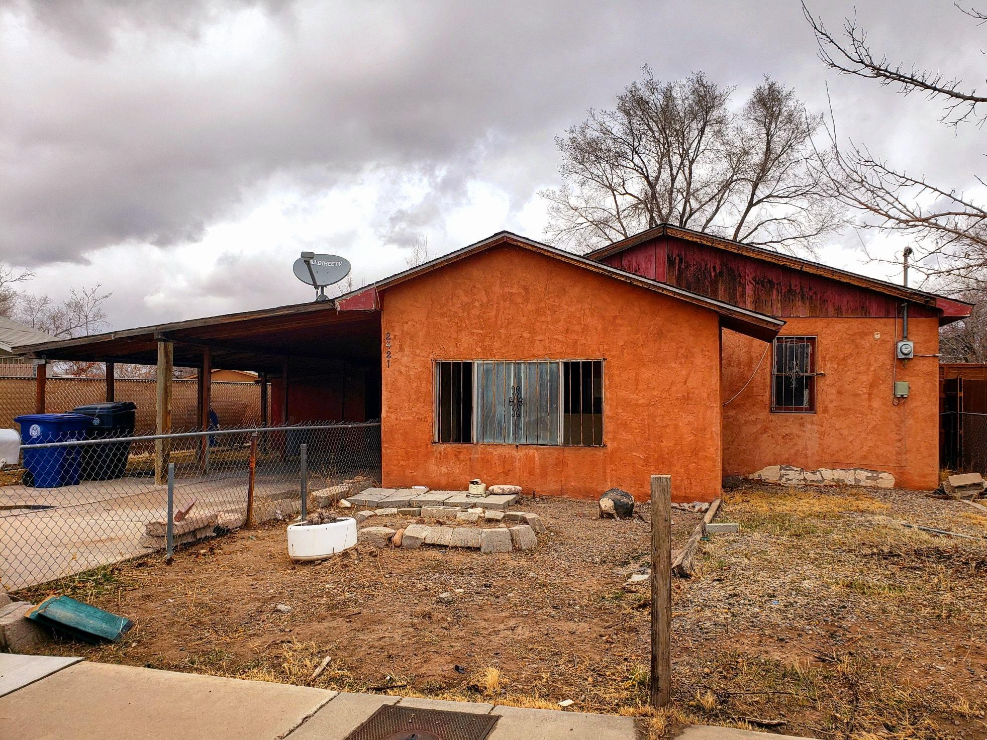 Bring your investor buyers! Home is being sold AS IS. Great location...close to UNM. Home needs some elbow grease and TLC.