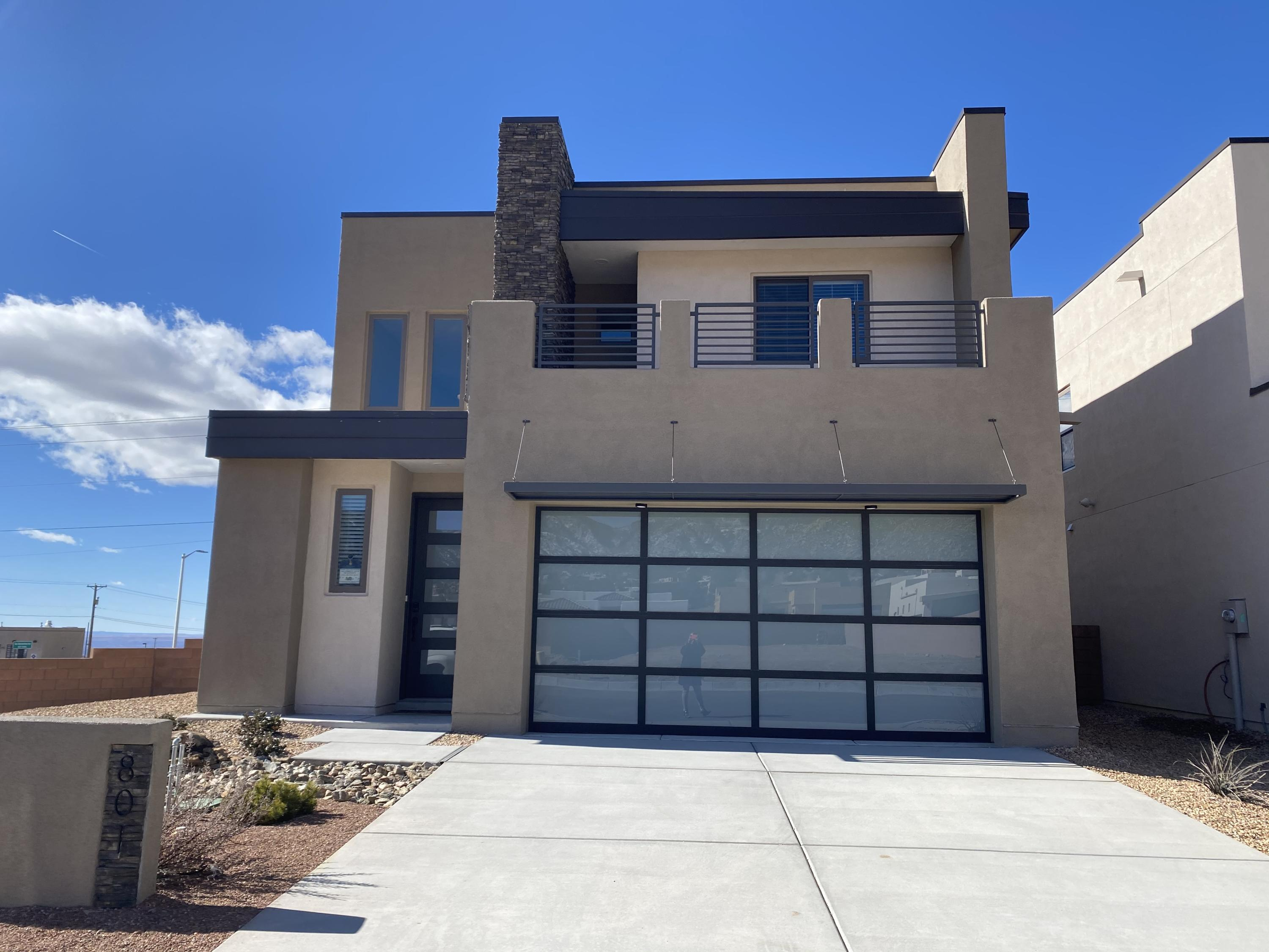 Open the doors to this beautiful home and discover a brand new Abrazo community in Northeast Albuquerque. Hawks Landing is the first to see some of Abrazo's newest floor plans and contemporary designs. This home not only has some of the best views, but also the first Cabo in Hawks Landing. This Cabo is a two-story, has 4 bedrooms, 3.5 baths, and 2,700 SQ FT. This beautiful Cabo has been designed by Abrazo's in-house designer, with elements that infuse warm colors in order to make this home modern. All of these features together, create an dazzling, modern feel! This home's balcony comes with  views of the Sandias, pairing perfectly with your morning coffee!