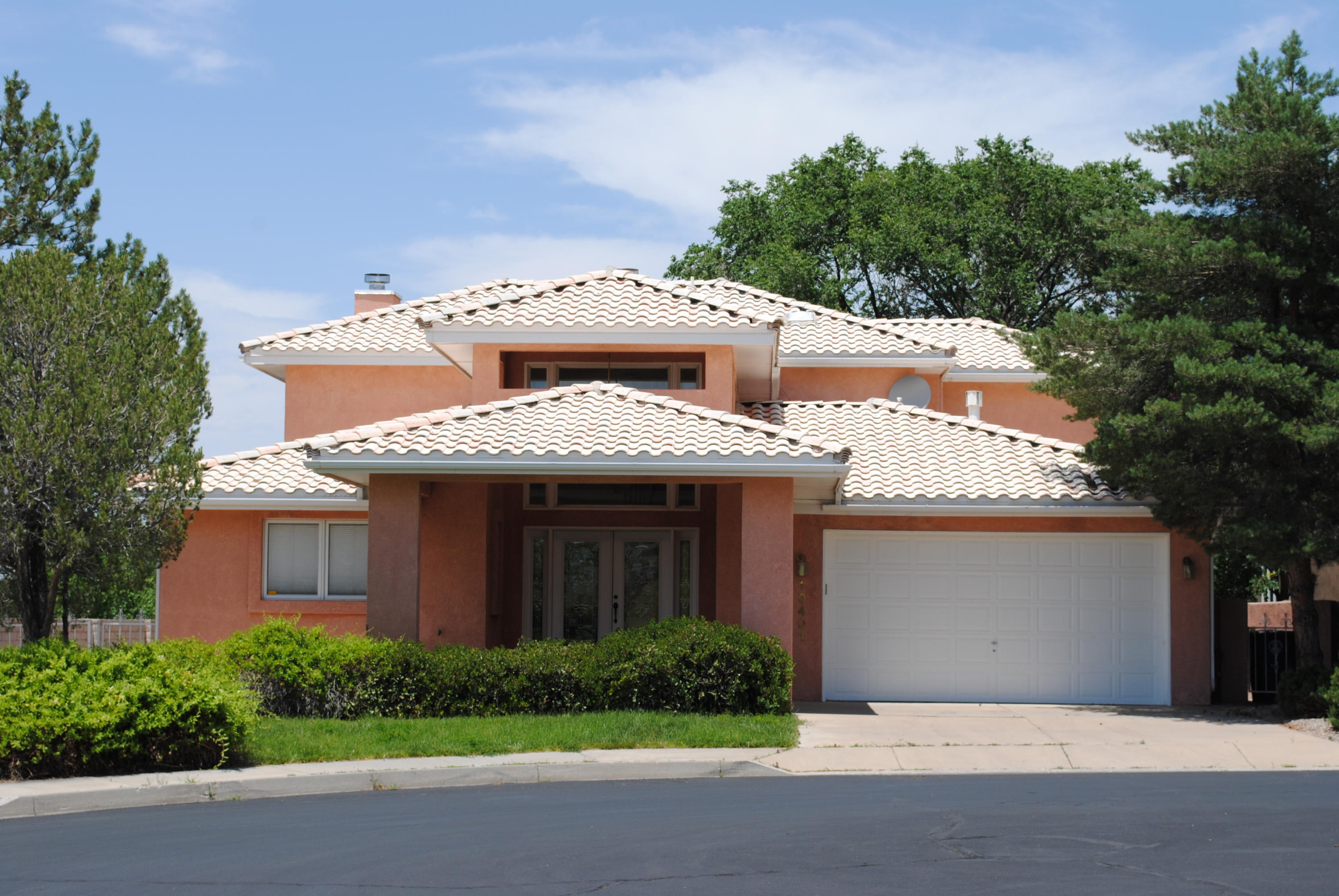 One of a kind Tanoan Home on the Golf Course backing to the Sandia 9. Covered circle driveway. Double glass doors greet you and open to a grand staircase in the foyer where travertine tile floors await. Lower level bedrooms share a Jack n Jill Bath. 3rd room with built-ins and wet bar can serve numerous purposes - Office, hobby or 4th bedroom. Step down living room with stone fireplace and handscraped hardwood flooring. Granite kitchen counters and island cooktop. Breakfast nook and formal dining room with built-in corner cabinets for your dinnerware. Sunroom with more travertine completes the lower level. Entire upper level of the home is the master suite. Nicely arranged bedroom with bed platform also has a wet bar and plenty of room for a chaise or sofa. Fantastic views to the West look