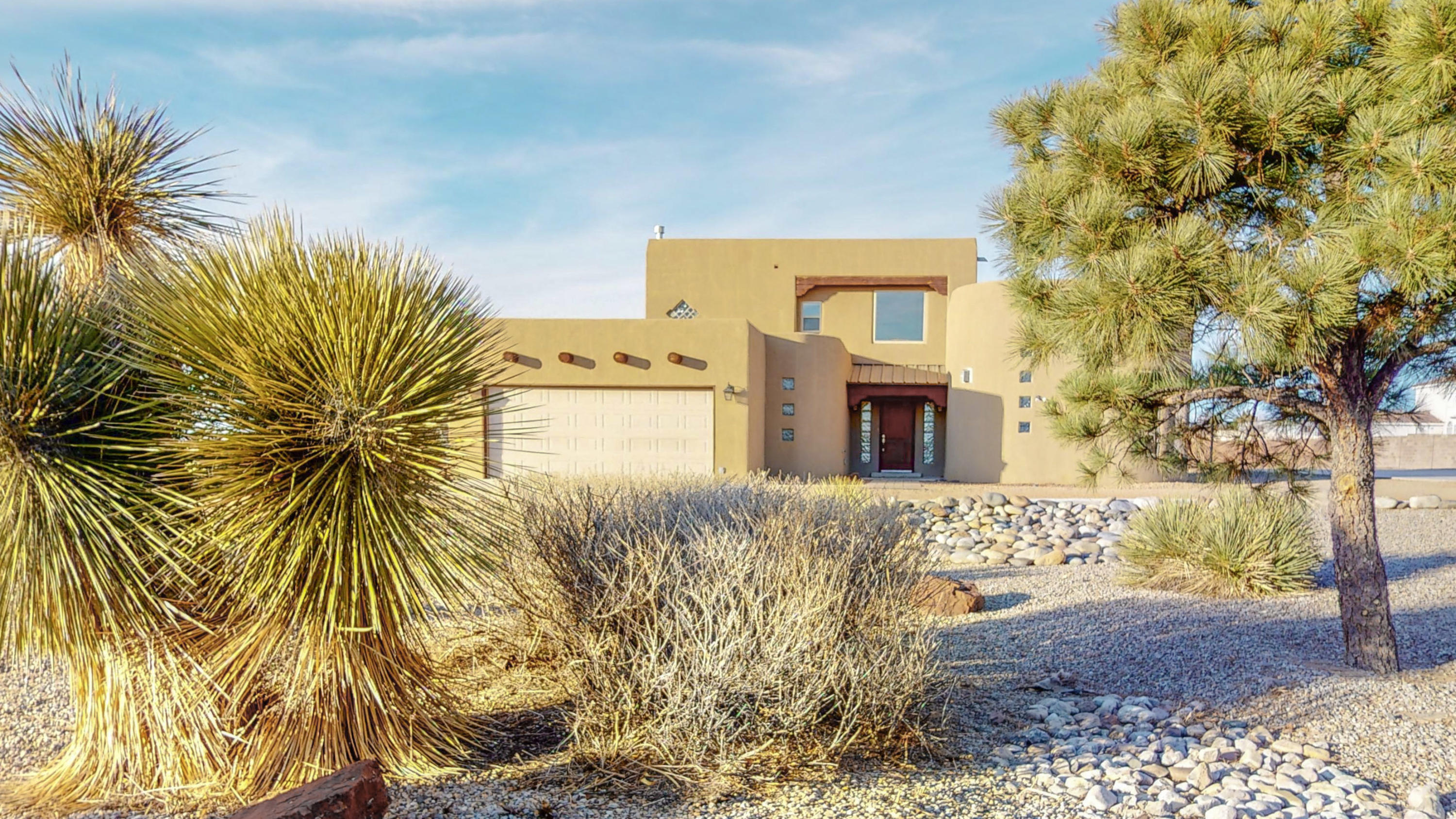 Looking for a great home in North Albuquerque Acres in  North Star/ Desert Ridge/ La Cueva School district?   Come see this 2624 sf 2 story Pueblo style home on .89 acres with 4 bedrooms, 3 baths, oversized 2 car garage & radiant heat.  Spacious , great room with high ceilings, wood laminate flooring, huge vigas & Sandia mountain views opens to dining room and kitchen.  Kitchen has a large walk in pantry, granite countertops and double door access to the covered patio .  House is on city water & city sewer and has a Vivint solar system for greener living. No HOA ! Big lot has a professionally installed, concrete, basketball court, a playground,  lots of room for a pool, RV parking or your other toys.   Come see it today!