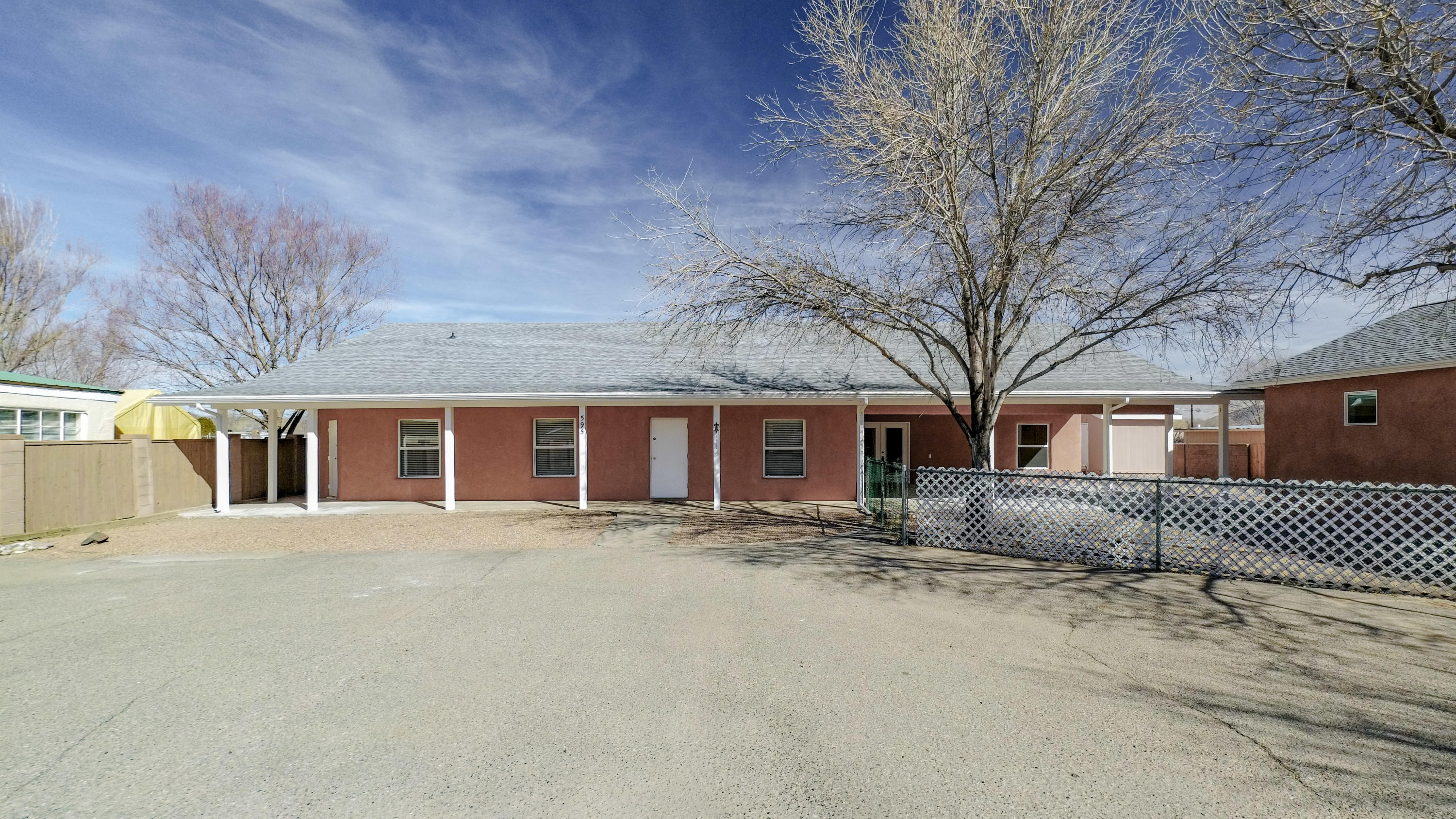 Nearly 3000 square feet on .5 acres in the highly desiriable north valley of Los Ranchos de Albuquerque.  This home is in excellent condition with an electric gate for added security.  Home features 2 living areas, ss appliances, granite counter tops in the kitchen, and one living area can be converted to a bedroom.  The roof on the house and shed is less than 2 years old. Oversized garage is insulated and is 22' wide by 33.5' deep.  The garage doors are 8 feet tall.  A portion of the garge could be converted to a studio or casita.  Property is zoned R2 which allows a casita (conditioned by the Village of Los Ranchos)